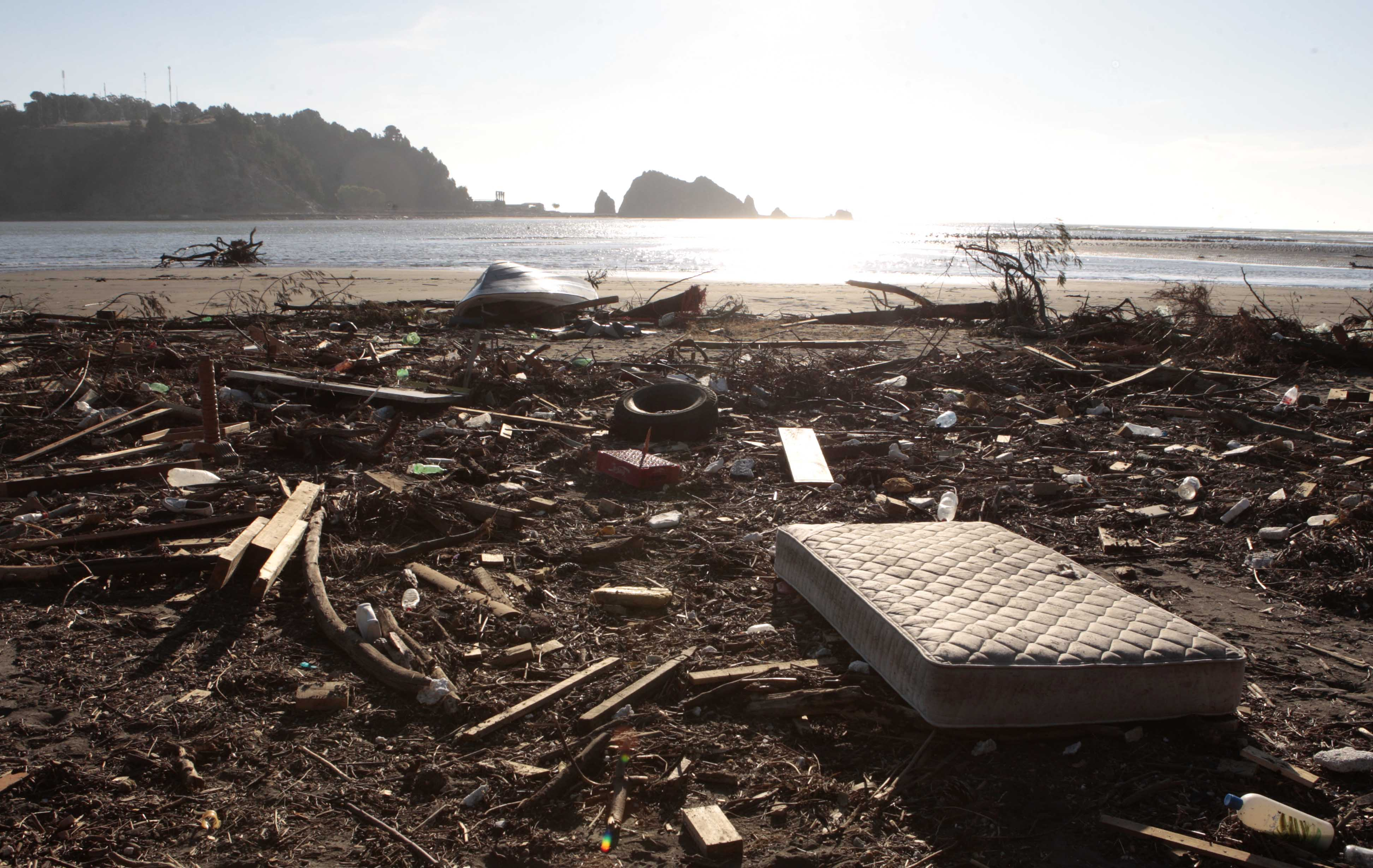Earthquake debris sits on the shore of the Maule river in Constitucion, Chile, Friday, March 5 , 2010. An 8.8-magnitude earthquake struck central Chile on Feb. 27, causing widespread damage. (AP Photo/Luis Hidalgo)