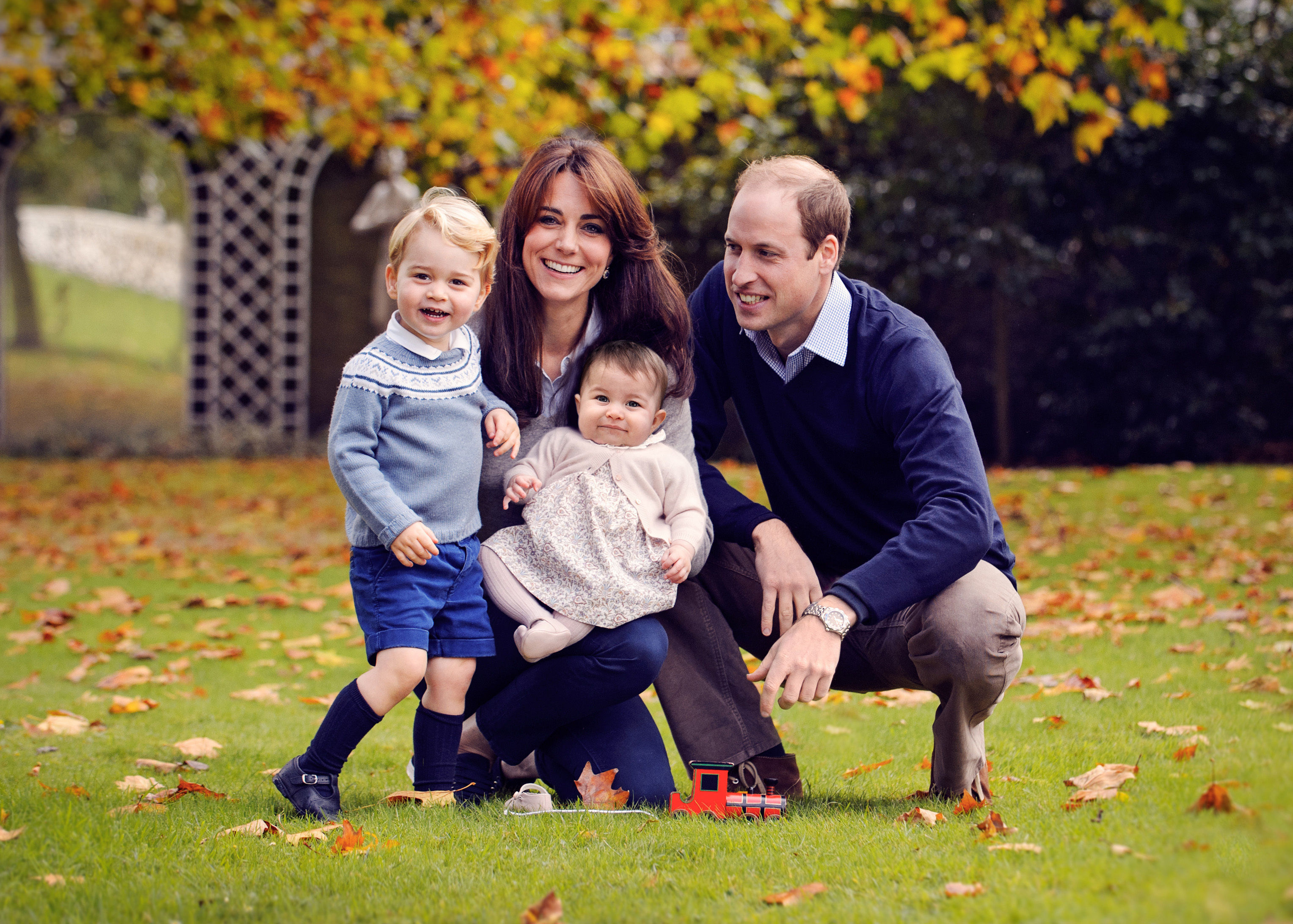 In this October handout image provided by Kensington Palace on Dec. 18, 2015, Prince William, Duke of Cambridge, and Catherine, Duchess of Cambridge, pose for a portrait with their children, Prince George and Princess Charlotte.