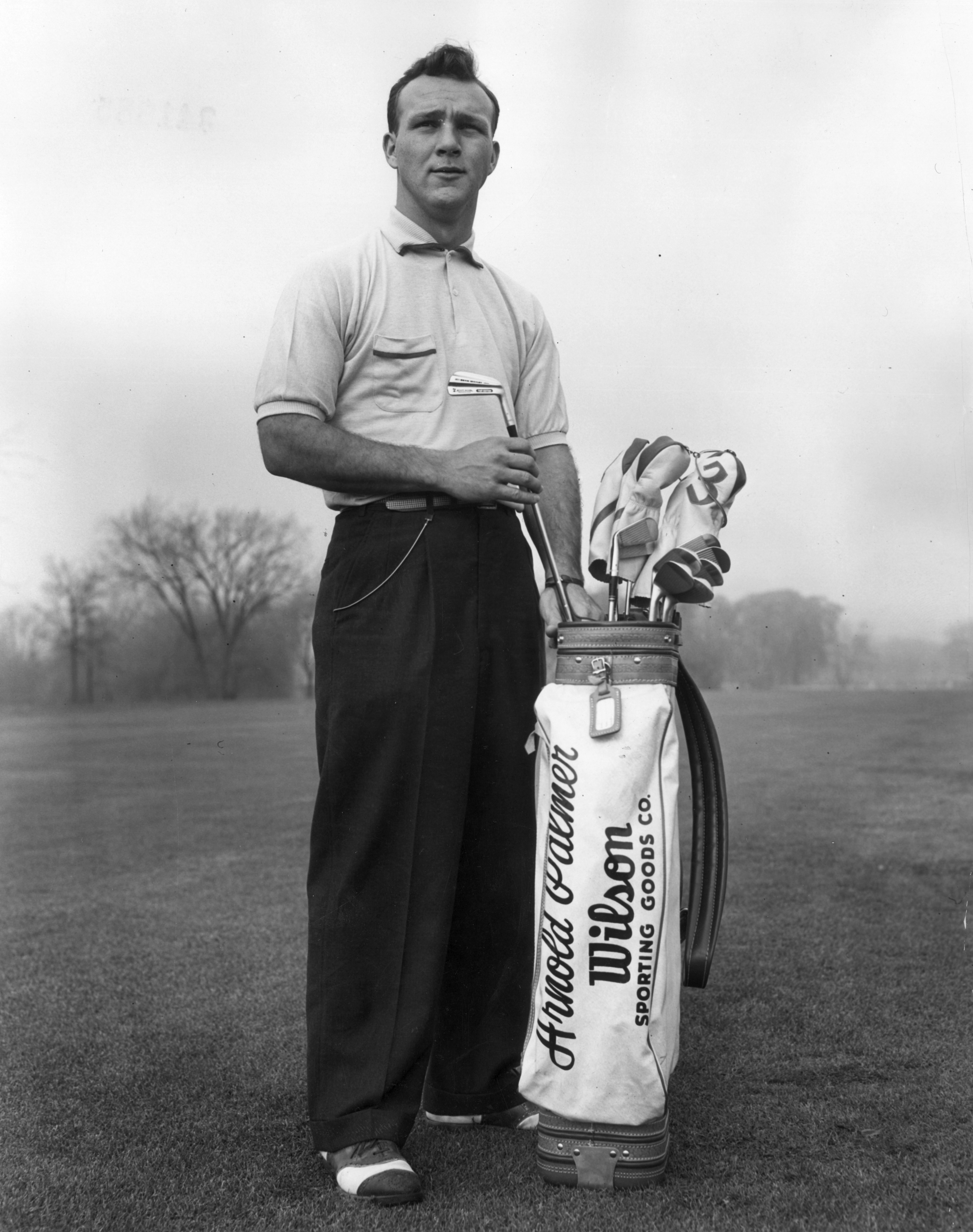 A portrait of American golfer Arnold Palmer pulling a driving iron from a golf bag on a golf course circa 1953. Palmer died Sunday in Pittsburgh. He was 87.