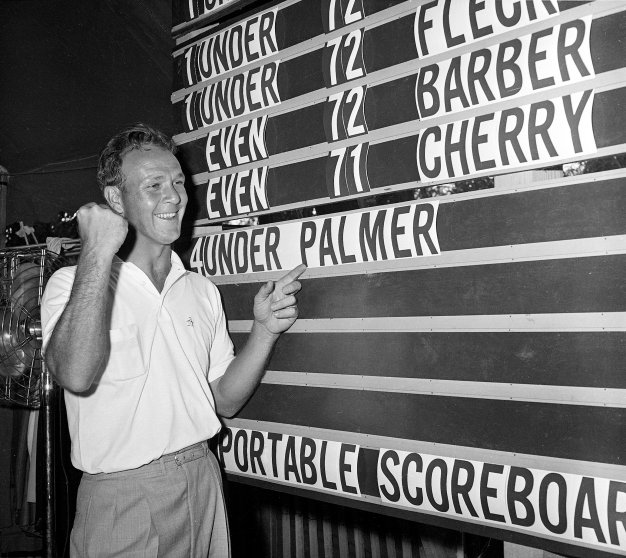 Arnold Palmer points to his name on the press tent scoreboard during the National Open golf tournament at the Cherry Hills Country Club in Denver June 19, 1960.Arnold Palmer points to his name on the press tent scoreboard during the National Open golf tournament at the Cherry Hills Country Club in Denver June 19, 1960.