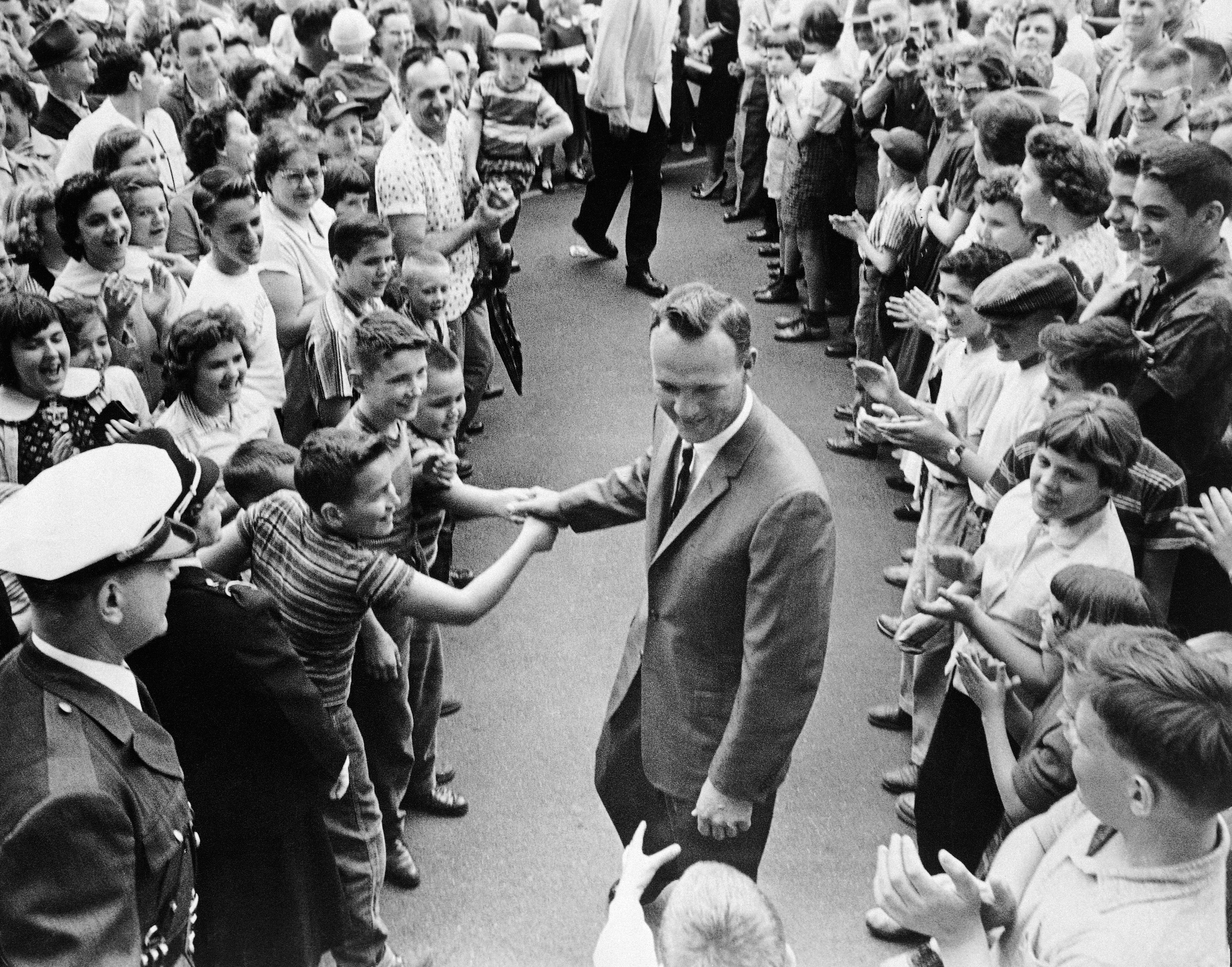 """Arnold Palmer is surrounded by applauding citizens of Latrobe, Pa.,  April 16, 1960 following a """"Welcome Home"""" parade in his honor. Palmer had won the Masters Golf Tournament."""