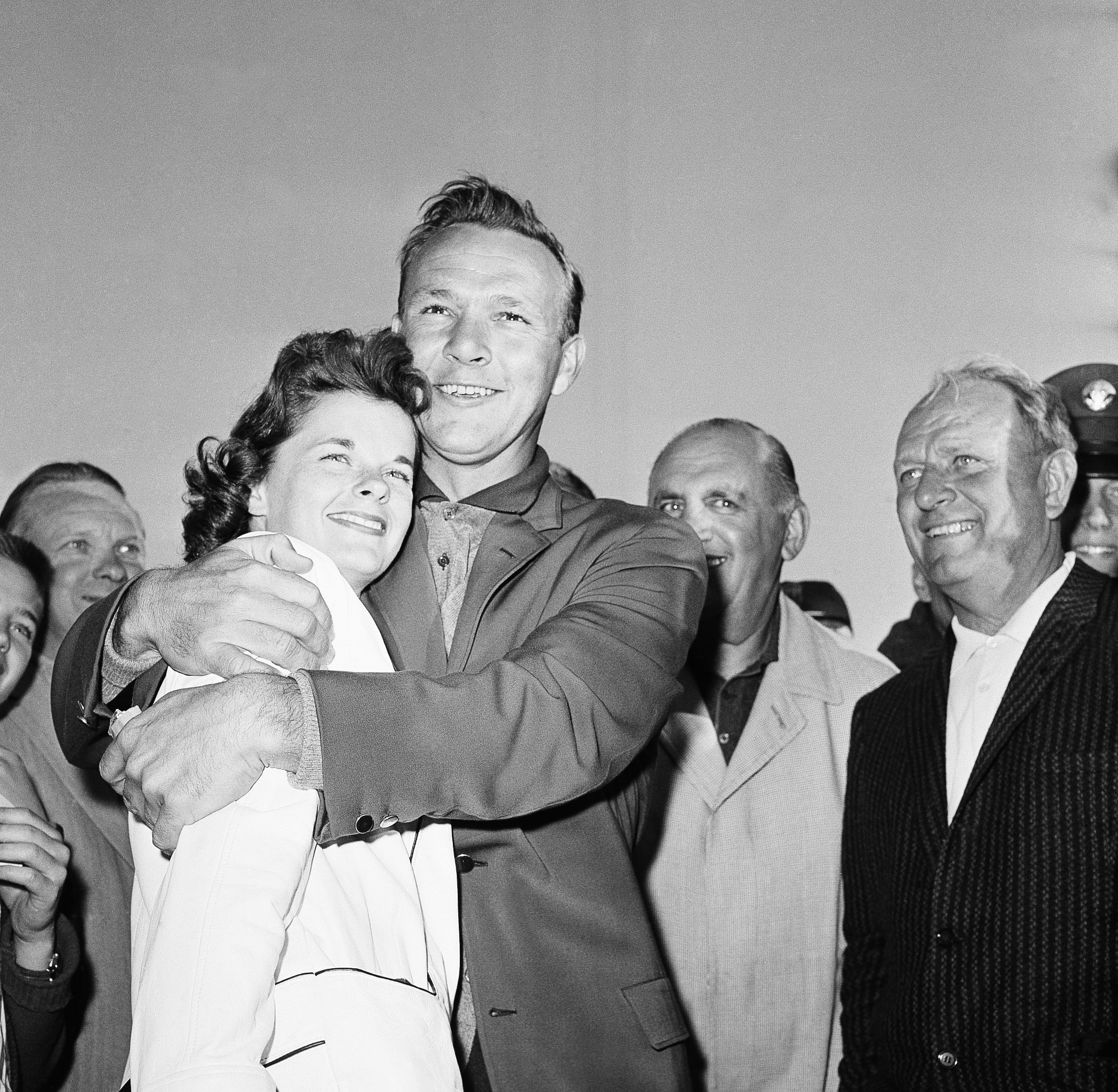 Arnold Palmer hugs his wife, Winnie, after winning the Masters Golf Tournament on April 10, 1960 in Augusta, Ga.