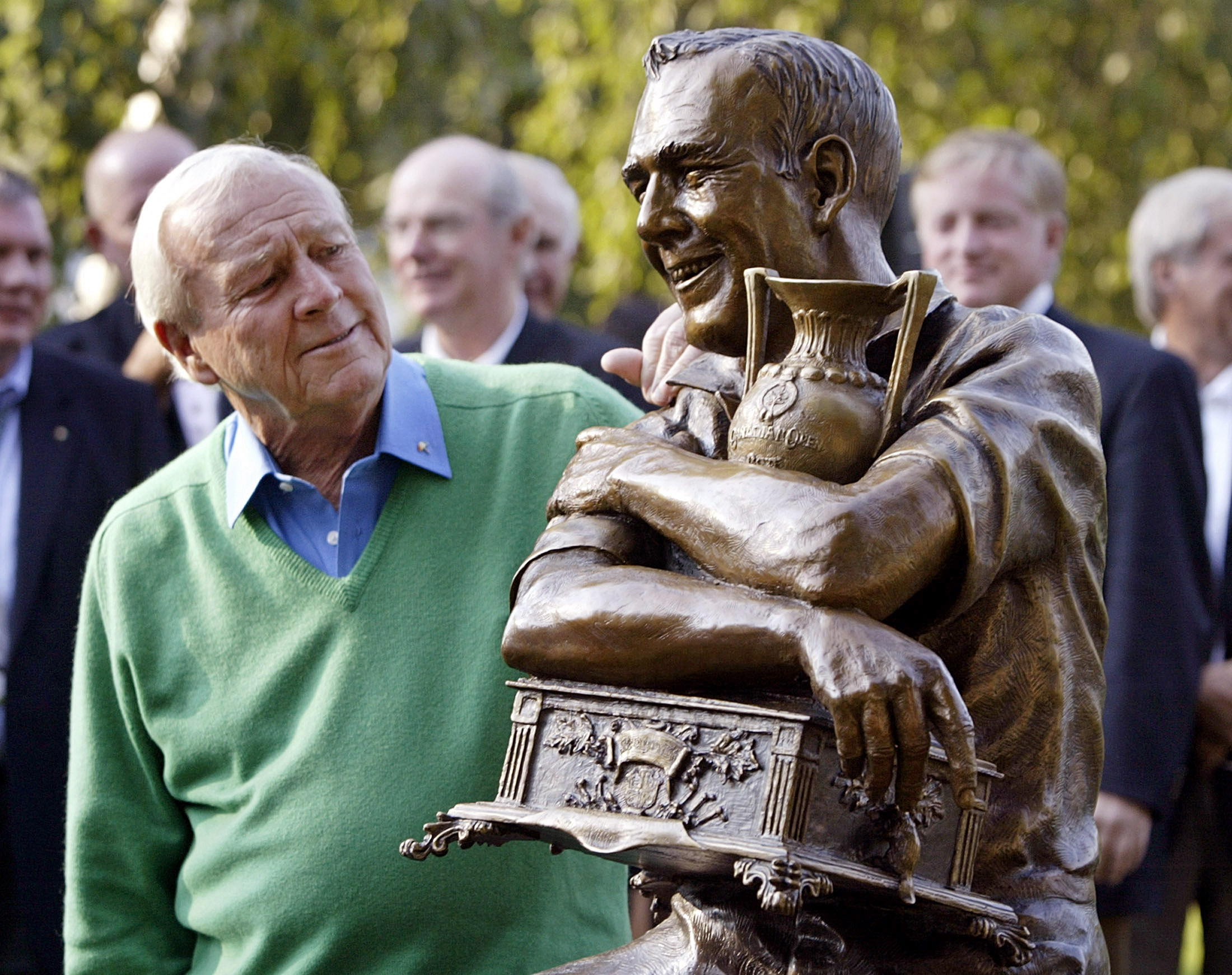 Palmer looks at a statue of himself commemorating the 50th anniversary of his first PGA tour win in 1955 in Toronto.