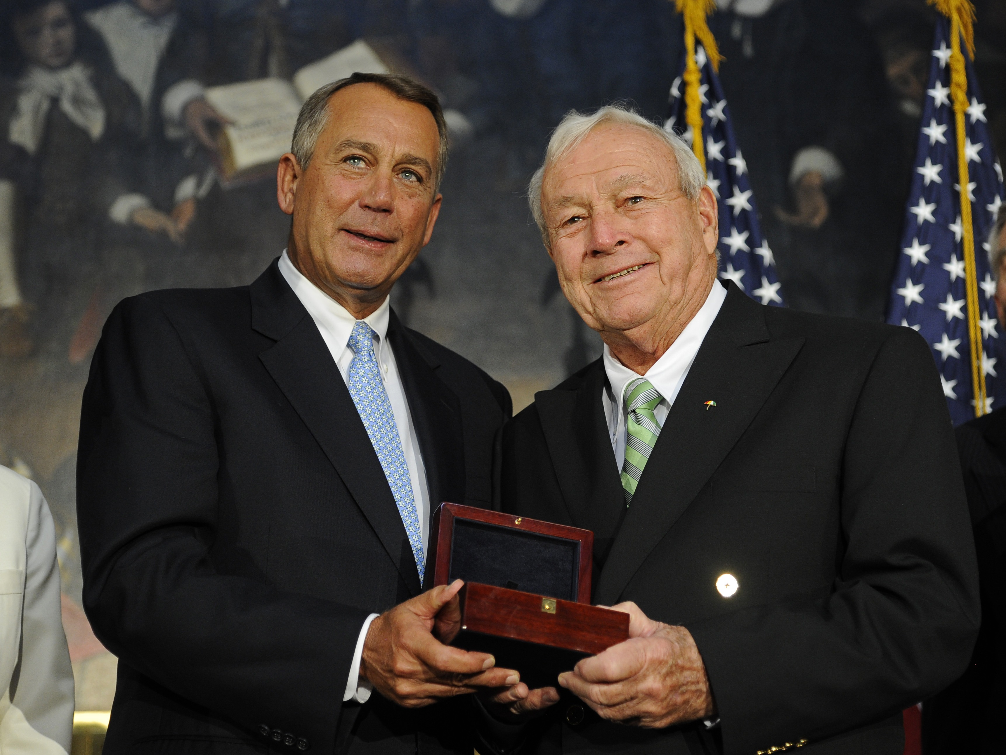 Speaker of the House John Boehner presents golfing legend Arnold Palmer with the Congressional Gold Medal at a special ceremony in the Rotunda of the Capitol Building on Sept.12, 2012 in Washington.
