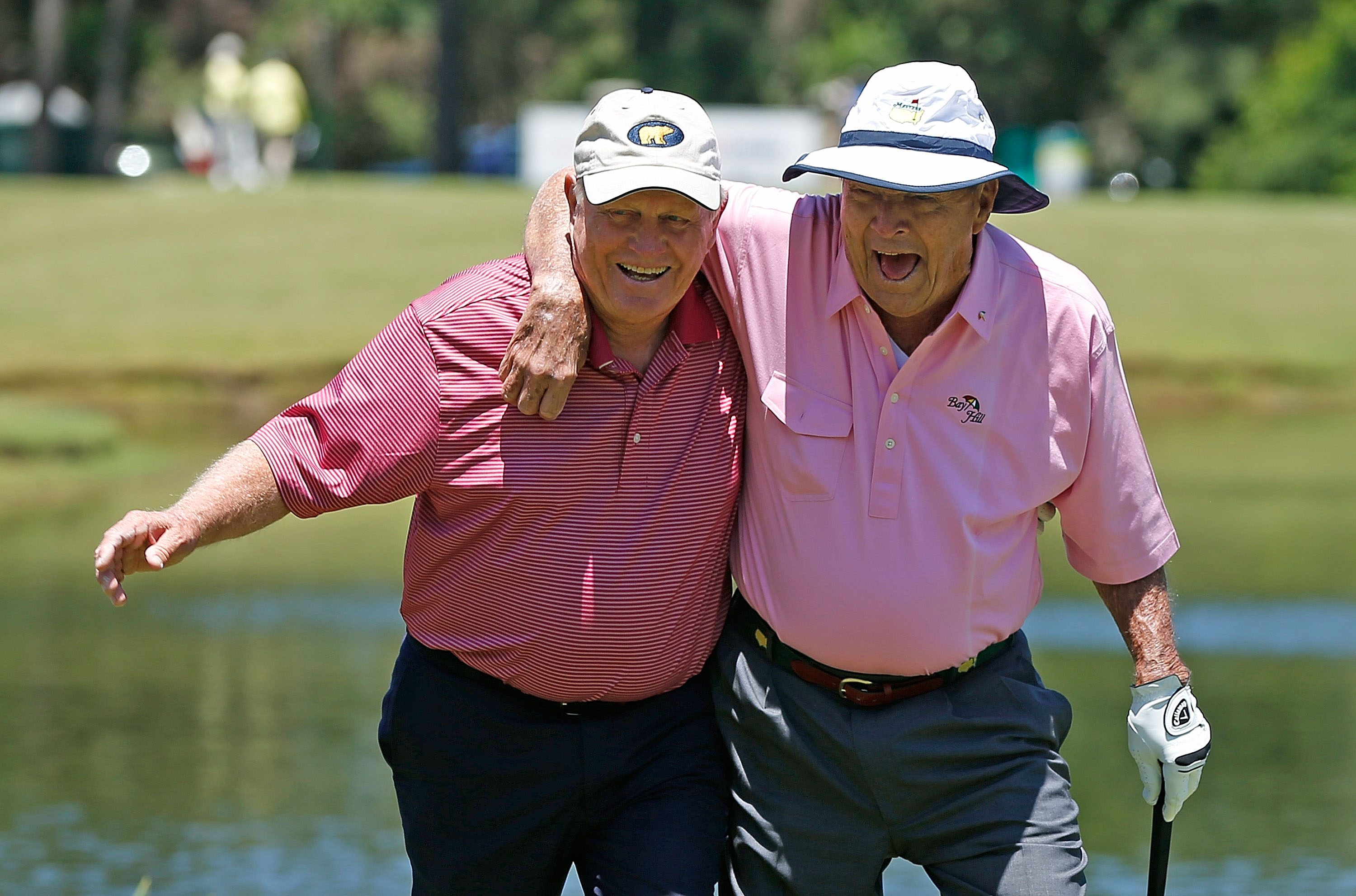 Jack Nicklaus and Arnold Palmer walk to the third green during the Greats of Golf exhibition at the Insperity Championship at the Woodlands Country Club on May 4, 2013 in Woodlands, Texas.