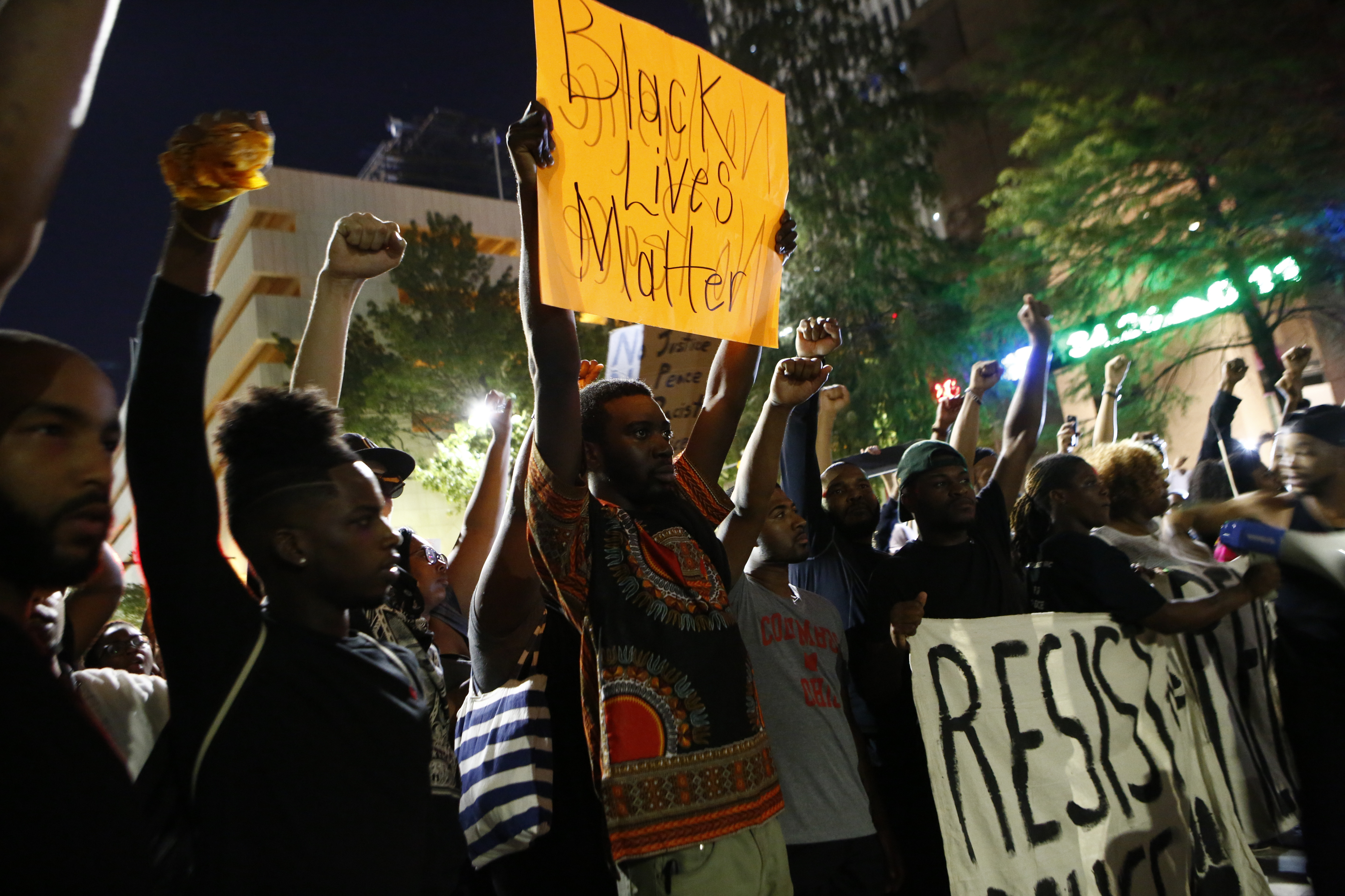 Residents and activists march in the streets amid heavy police and North Carolina National Guard presence as they protest the death of Keith Lamont Scott Sept. 23, 2016 in Charlotte, North Carolina.