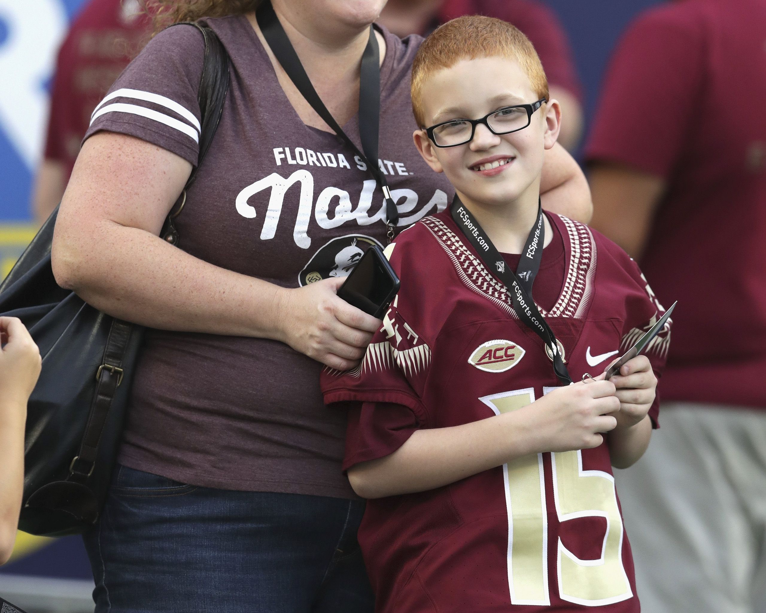 Bo Paske and mother Leah Paske are seen on the sideline prior to the Camping World Kickoff between the Florida State Seminoles and the Mississippi Rebels at Camping World Stadium in Orlando on Sept. 5, 2016.