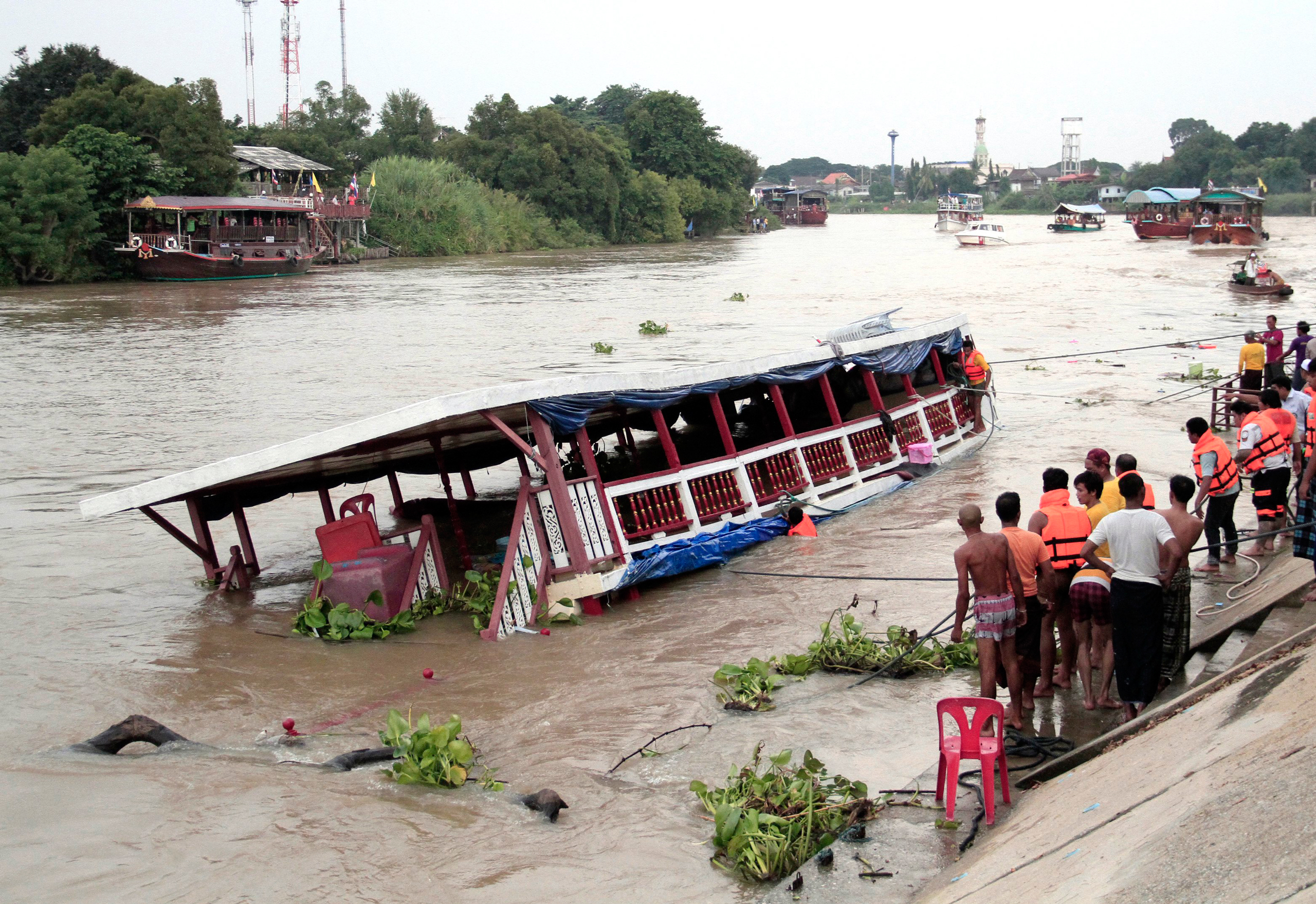 Thai news reports say at least 13 people were killed when a double-decker passenger boat carrying more than 100 people capsized in the Chao Phraya River north of Bangkok in Thailand on Sept. 18, 2016.