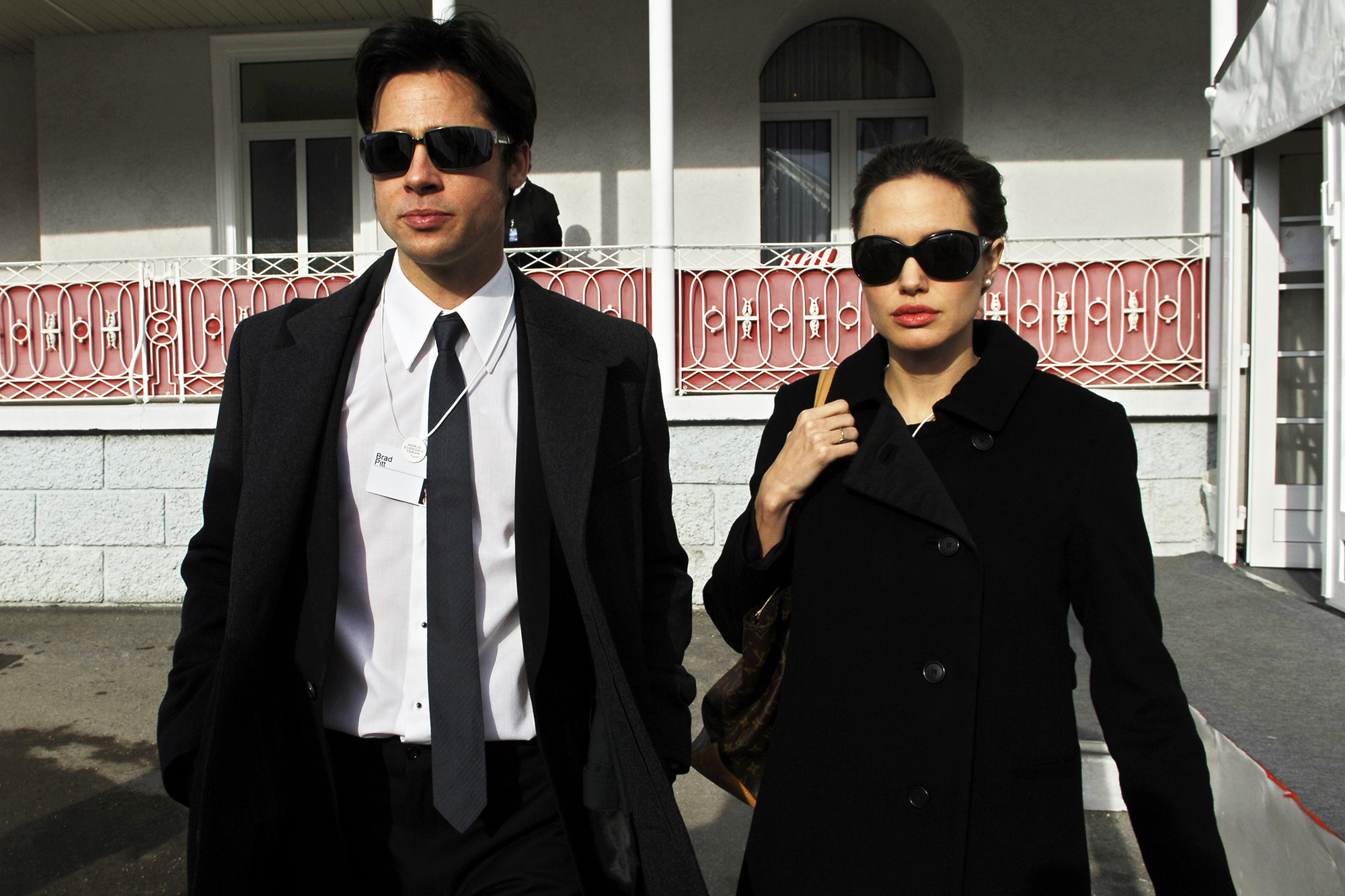 Brad Pitt and Angelina Jolie leave the Hotel Belvedere in Davos, on January 26, 2006.