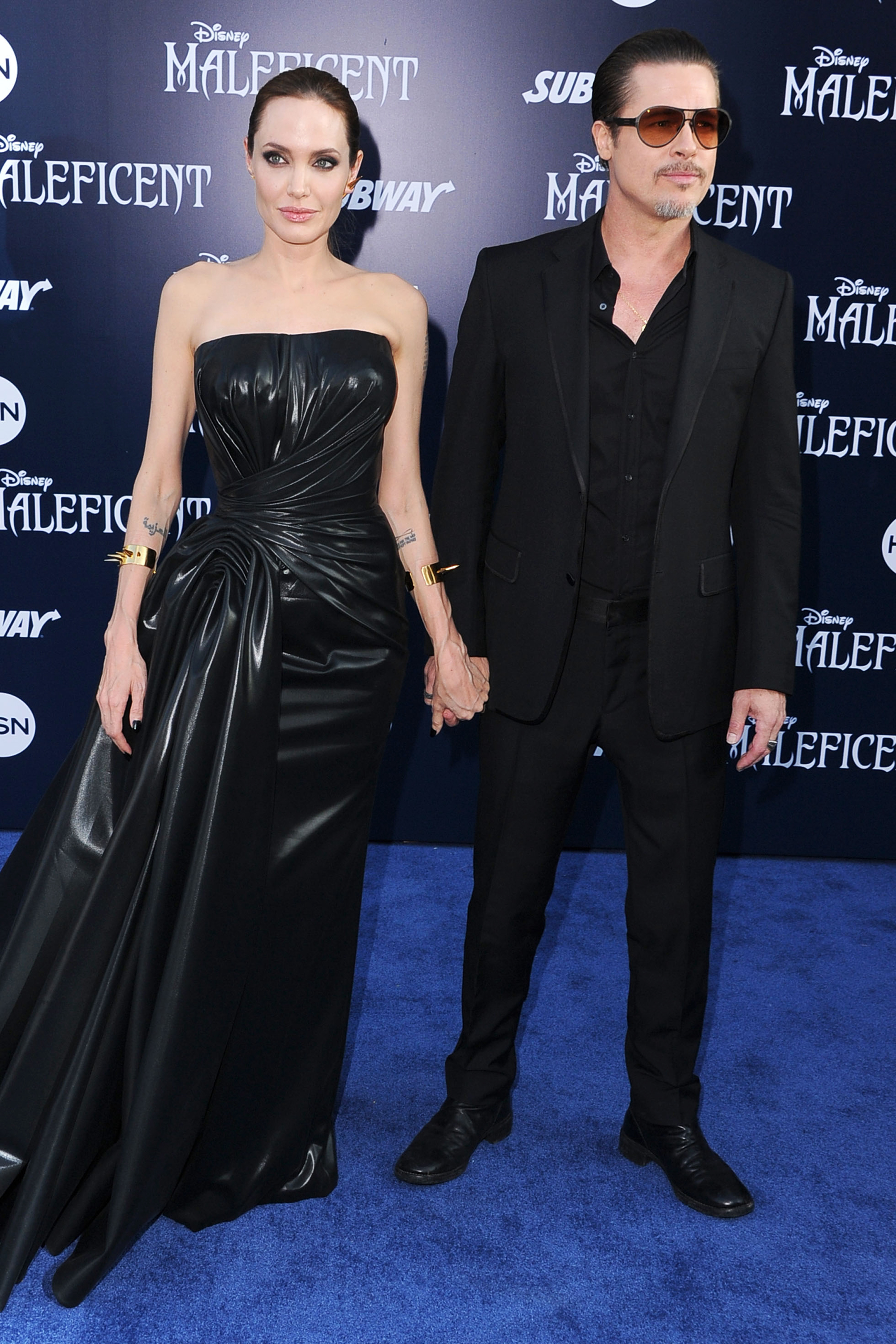 Angelina Jolie and Brad Pitt arrive premiere of Maleficent on May 28, 2014 in Hollywood, Calif.