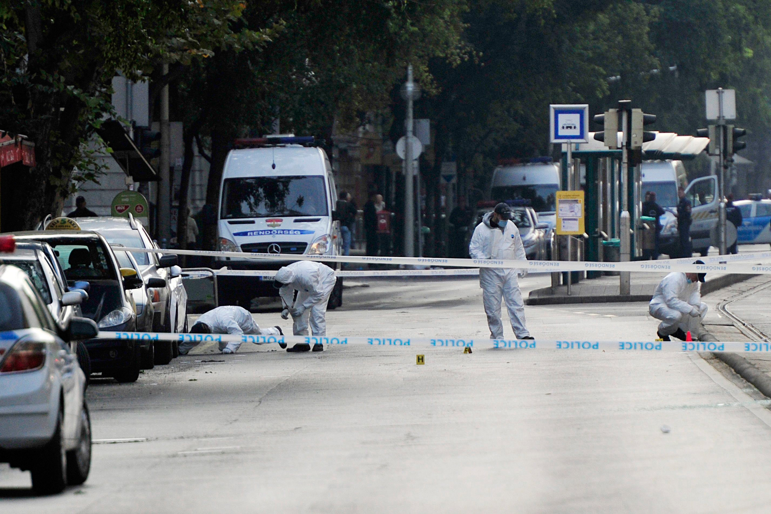 Police forensic experts examine the scene of an explosion that occurred late on Saturday night in central Budapest, Hungary, on Sept. 25, 2016.