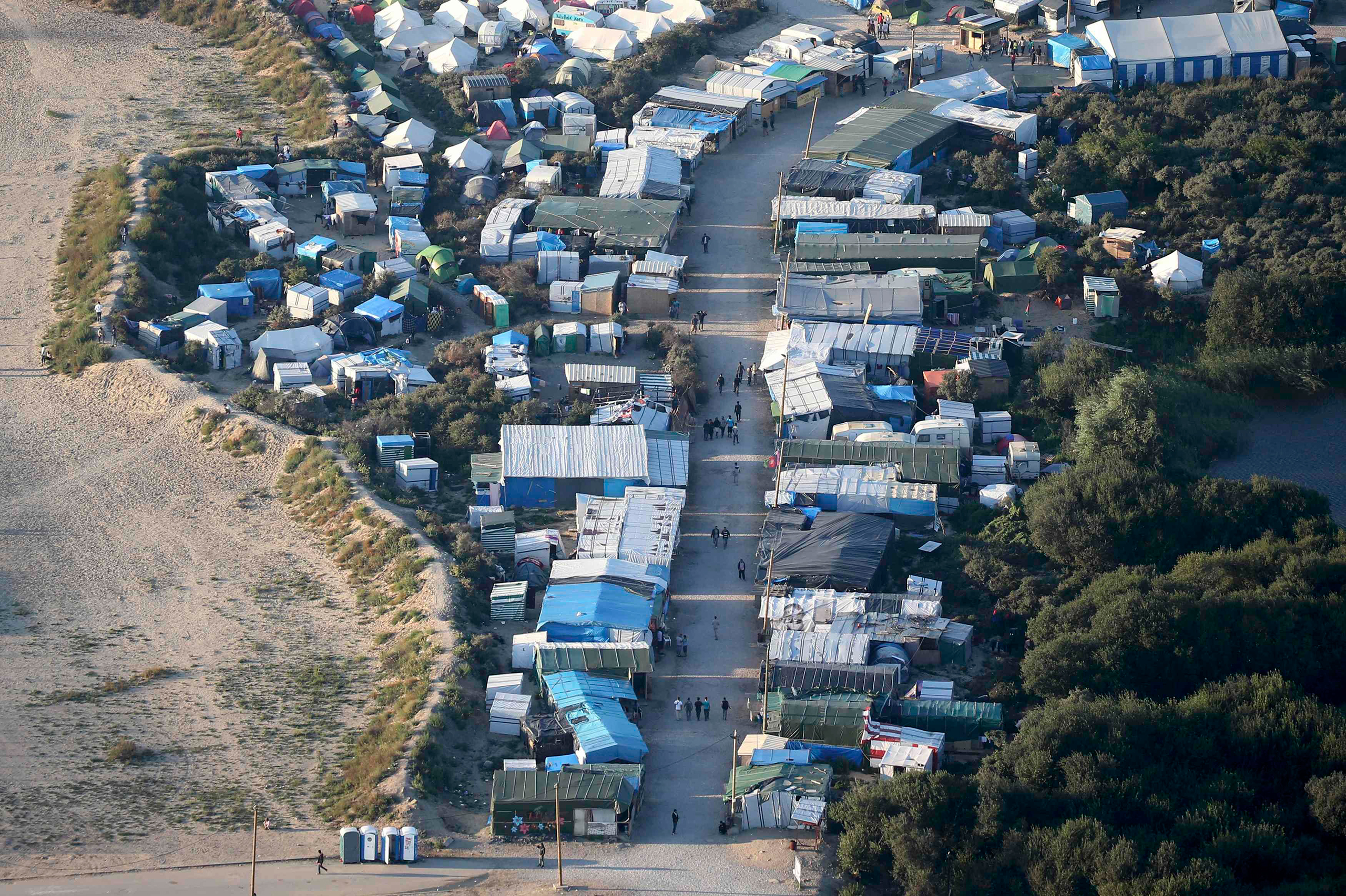 An aerial view shows makeshift shelters and tents where migrants live in what is known as  the Jungle,  a sprawling camp in Calais, France, on Sept. 7, 2016.