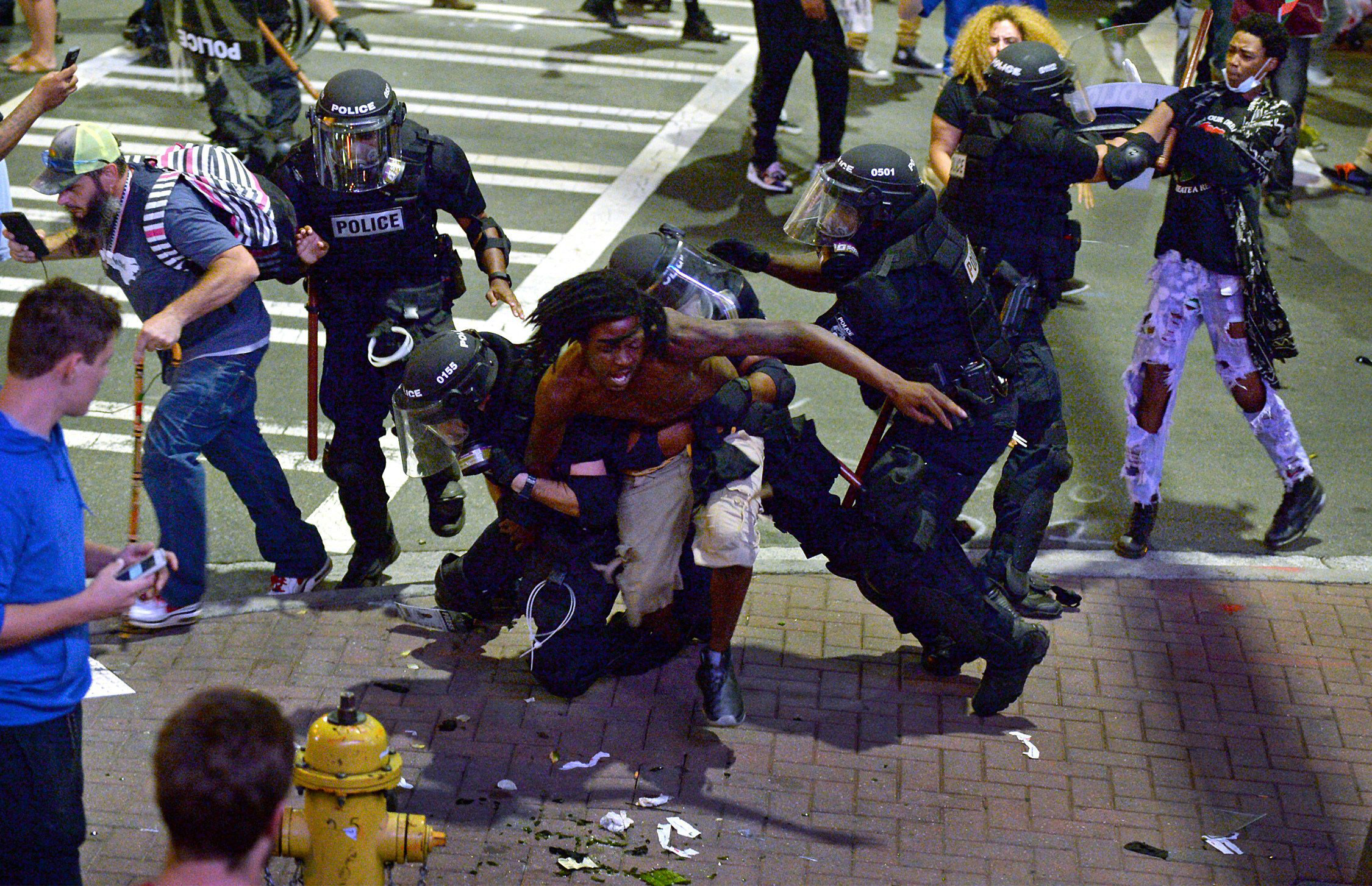 A protester is taken into custody by police officers in Charlotte, N.C., on Sept. 21, 2016.