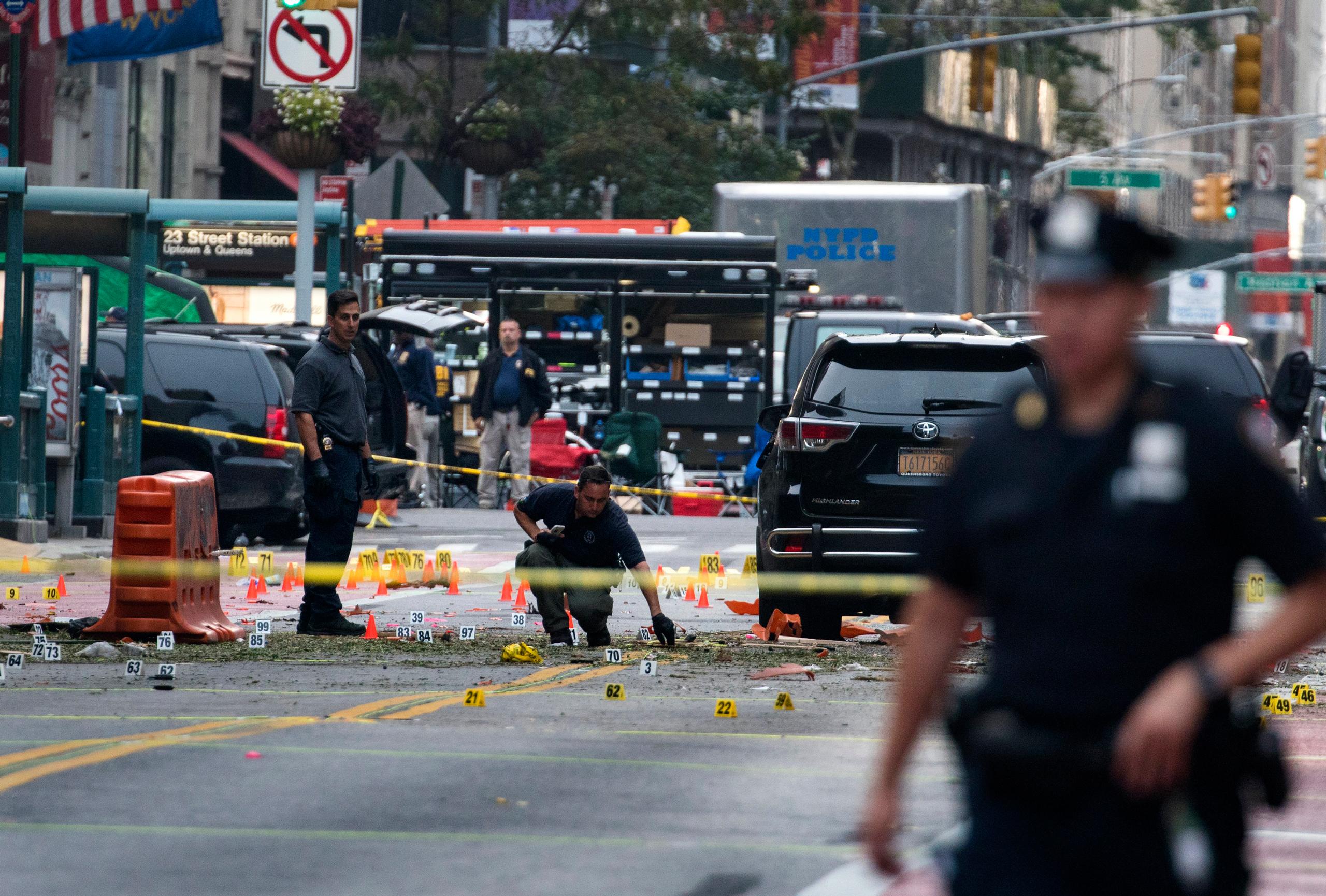 Crime scene investigators at the scene of an explosion in Manhattan's Chelsea neighborhood in New York on Sept. 18, 2016.