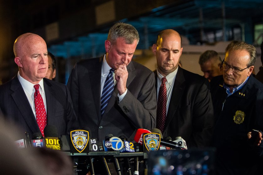 Mayor Bill de Blasio, center, and NYPD Chief of Department James O'Neill, left, react during a press conference near the scene of an explosion on West 23rd street in Manhattan's Chelsea neighborhood, in New York, Saturday, Sept. 17, 2016. Authorities say more than two dozen people were injured in the explosion Saturday night. (AP Photo/Andres Kudacki)