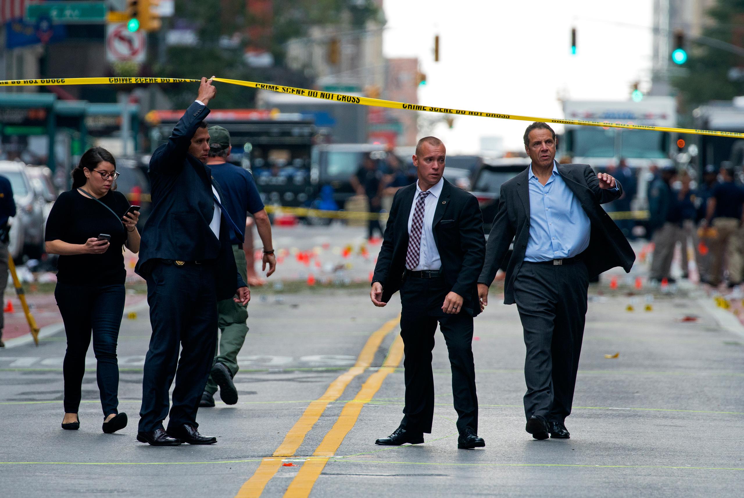 New York Gov. Andrew Cuomo, right, walks from the scene of an explosion in Manhattan's Chelsea neighborhood in New York on Sept. 18, 2016.