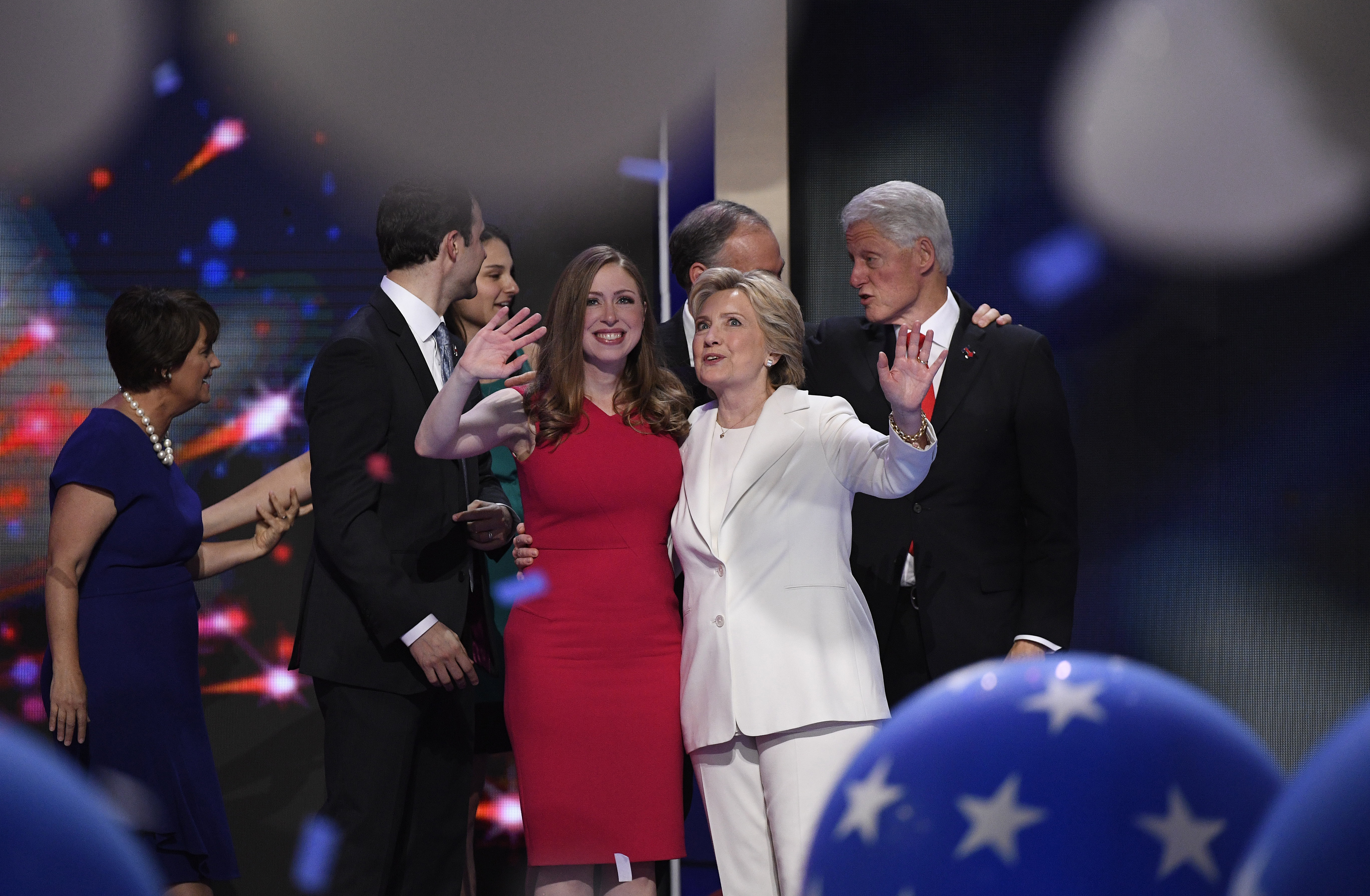 Hillary Clinton, 2016 Democratic presidential nominee, right, waves on stage with her daughter Chelsea Clinton during the Democratic National Convention (DNC) in Philadelphia, Pennsylvania, U.S., on Thursday, July 28, 2016. Division among Democrats has been overcome through speeches from two presidents, another first lady and a vice-president, who raised the stakes for their candidate by warning that her opponent posed an unprecedented threat to American diplomacy. Photographer: David Paul Morris/Bloomberg via Getty Images