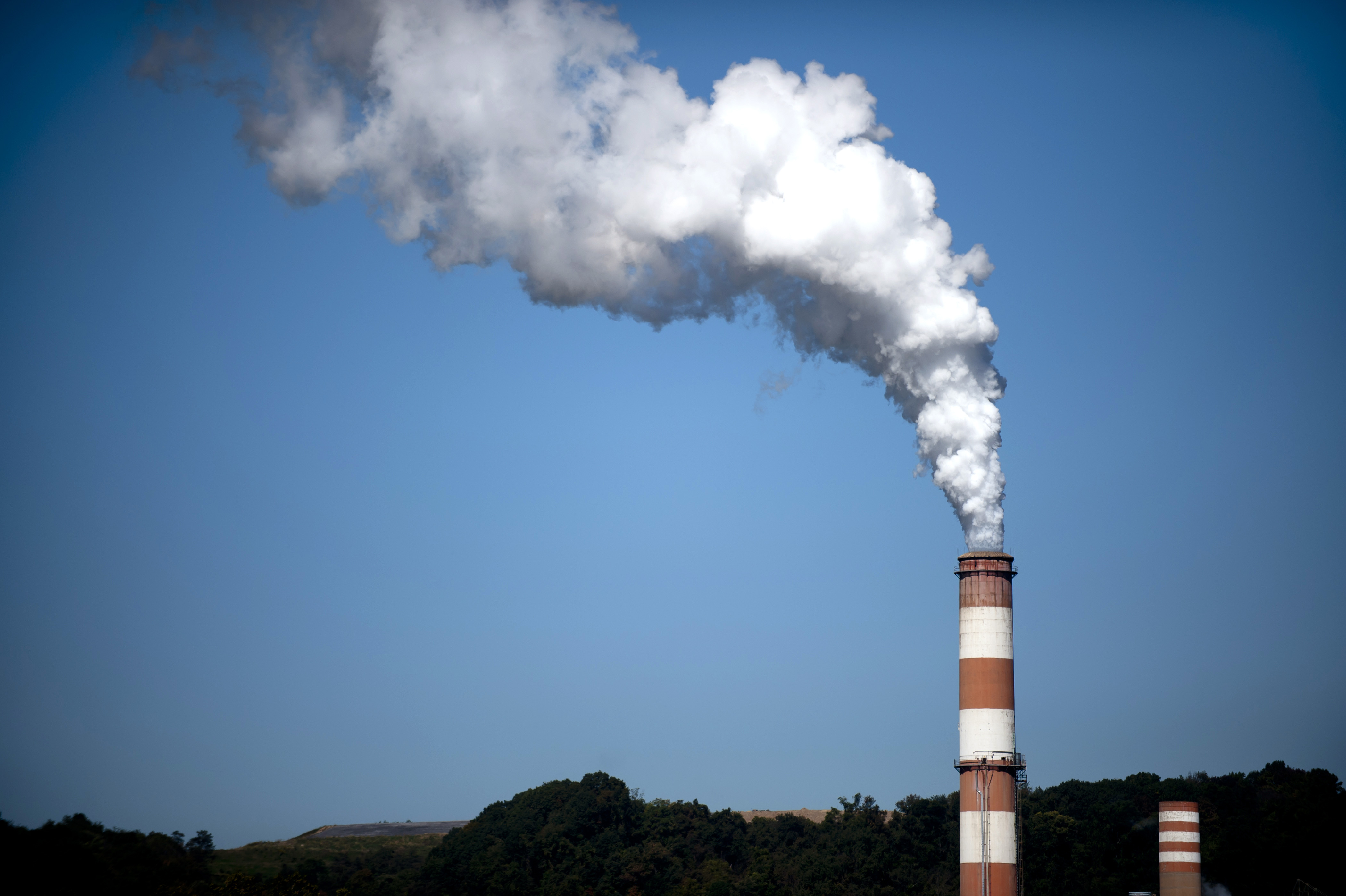 A plume of exhaust extends from the Mitchell Power Station, a coal-fired power plant built along the Monongahela River, 20 miles southwest of Pittsburgh, on Sept. 24, 2013 in New Eagle, Pennsylvania.