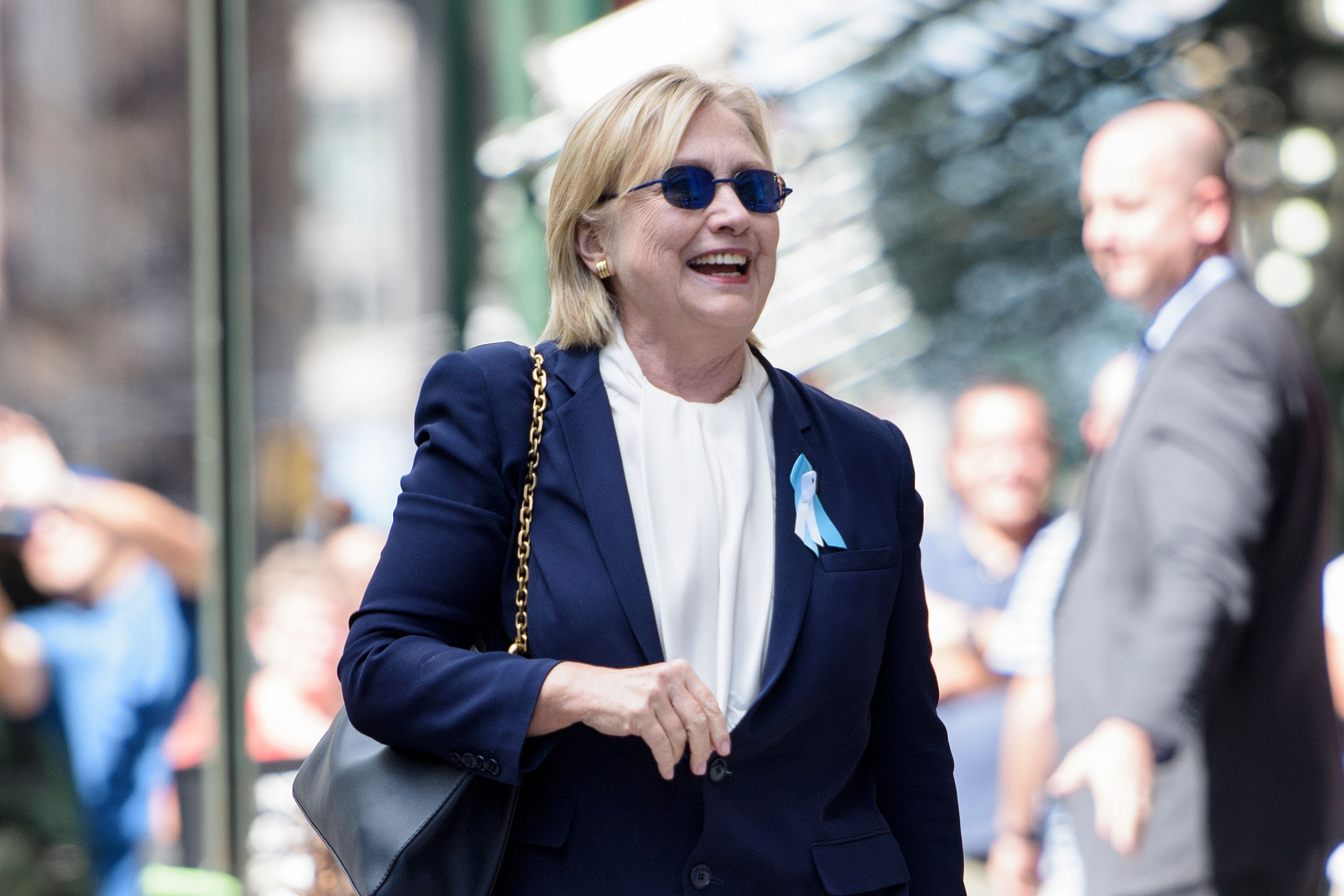 Hillary Clinton leaves her daughter's apartment building after resting on Sept. 11, 2016, in New York.
