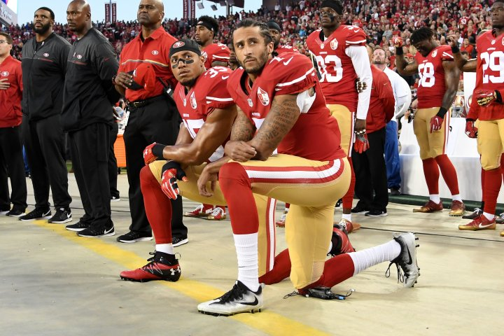 Colin Kaepernick #7 and Eric Reid #35 of the San Francisco 49ers kneel in protest during the national anthem prior to playing the Los Angeles Rams in their NFL game at Levi's Stadium in Santa Clara, Calif., on Sept. 12, 2016.