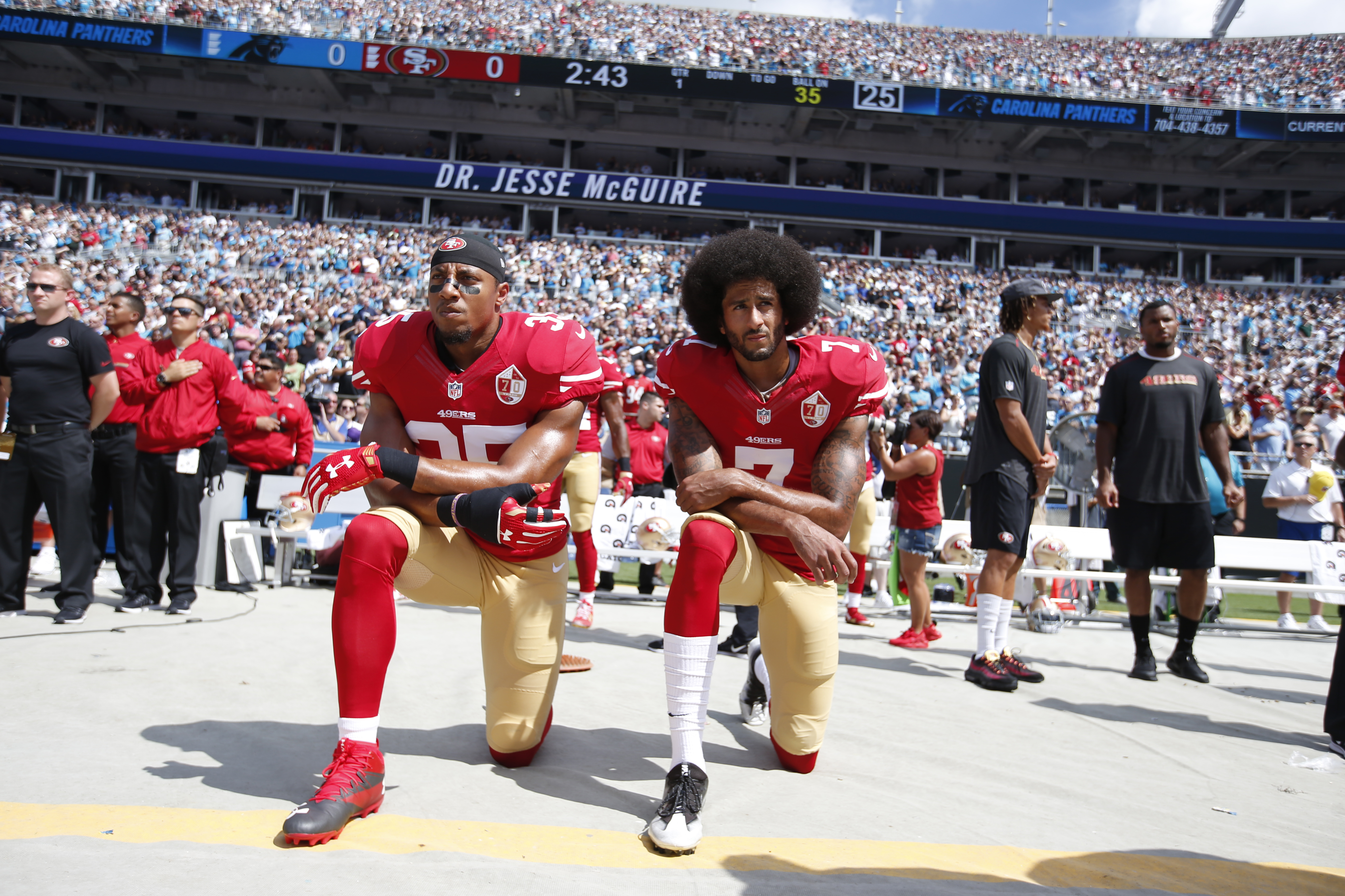 Eric Reid #35 and Colin Kaepernick #7 of the San Francisco 49ers kneel on the sideline, during the anthem, prior to the game against the Carolina Panthers at Bank of America Stadium in Charlotte, N.C., on Sept. 18, 2016.