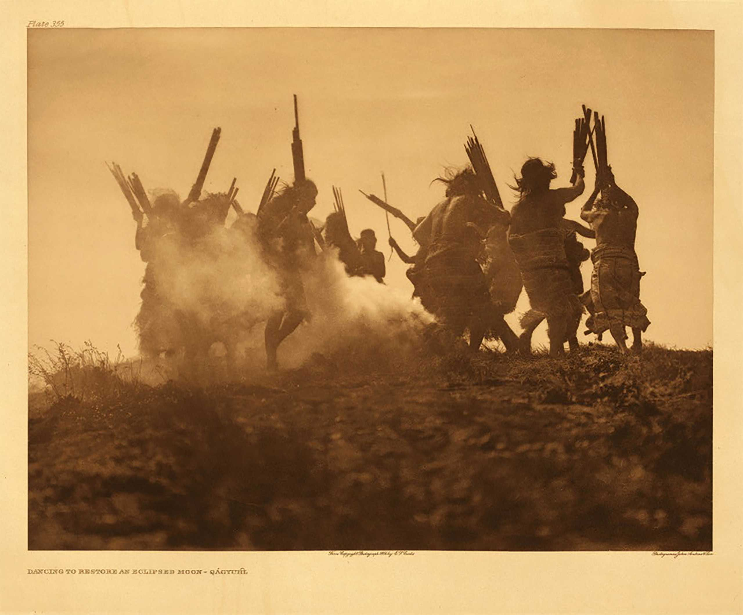 Edward S. Curtis Among the Kwakiutl, Fenimore Art Museum, N.Y.: Oct. 1 - Dec. 31                                                                                             (Caption: Dancing to restore an eclipsed moon – Qagyuhl, 1914)