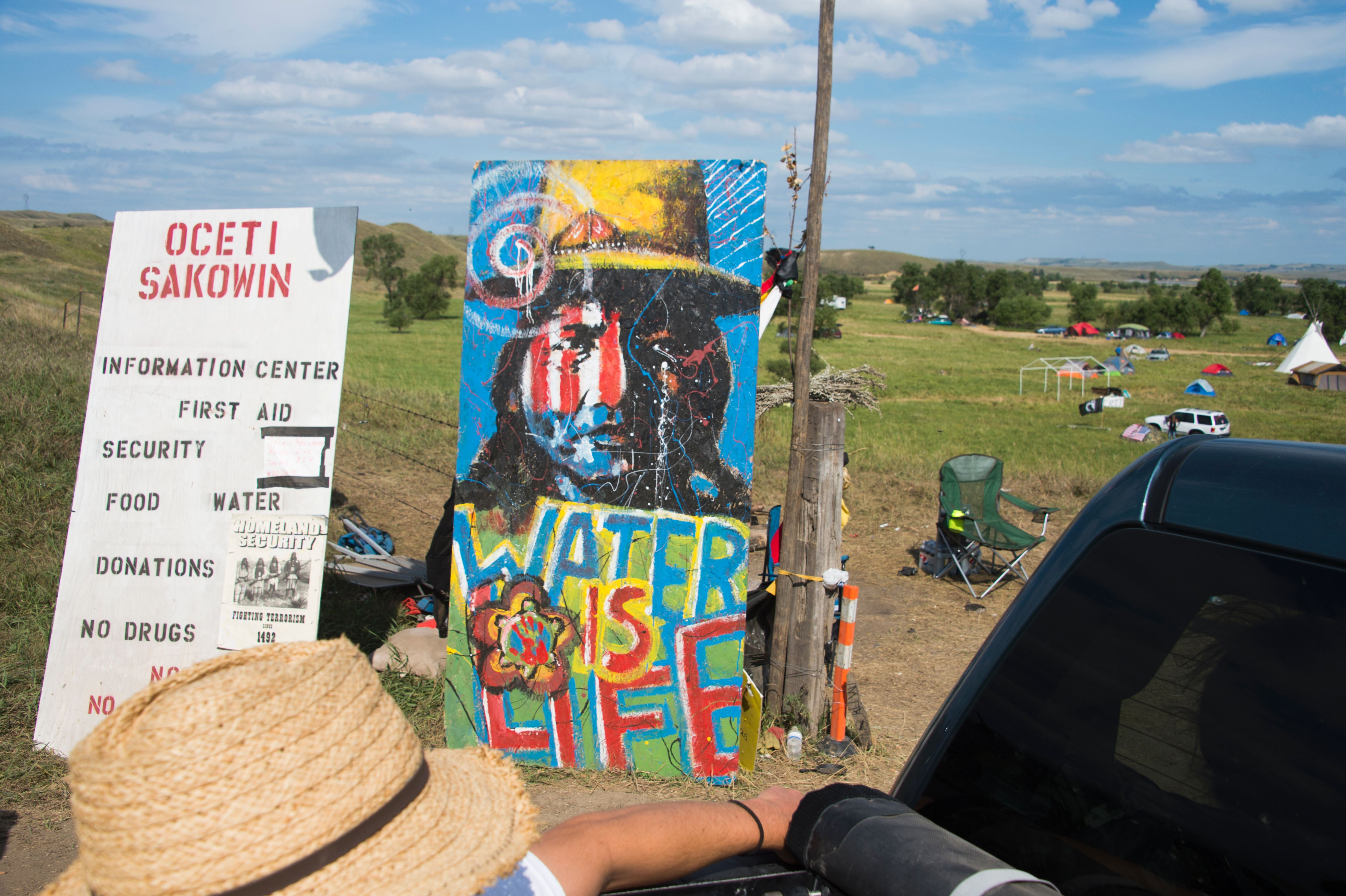 A sign welcomes visitors at the entrance to an oil pipeline protest encampment near Cannon Ball, N.D.