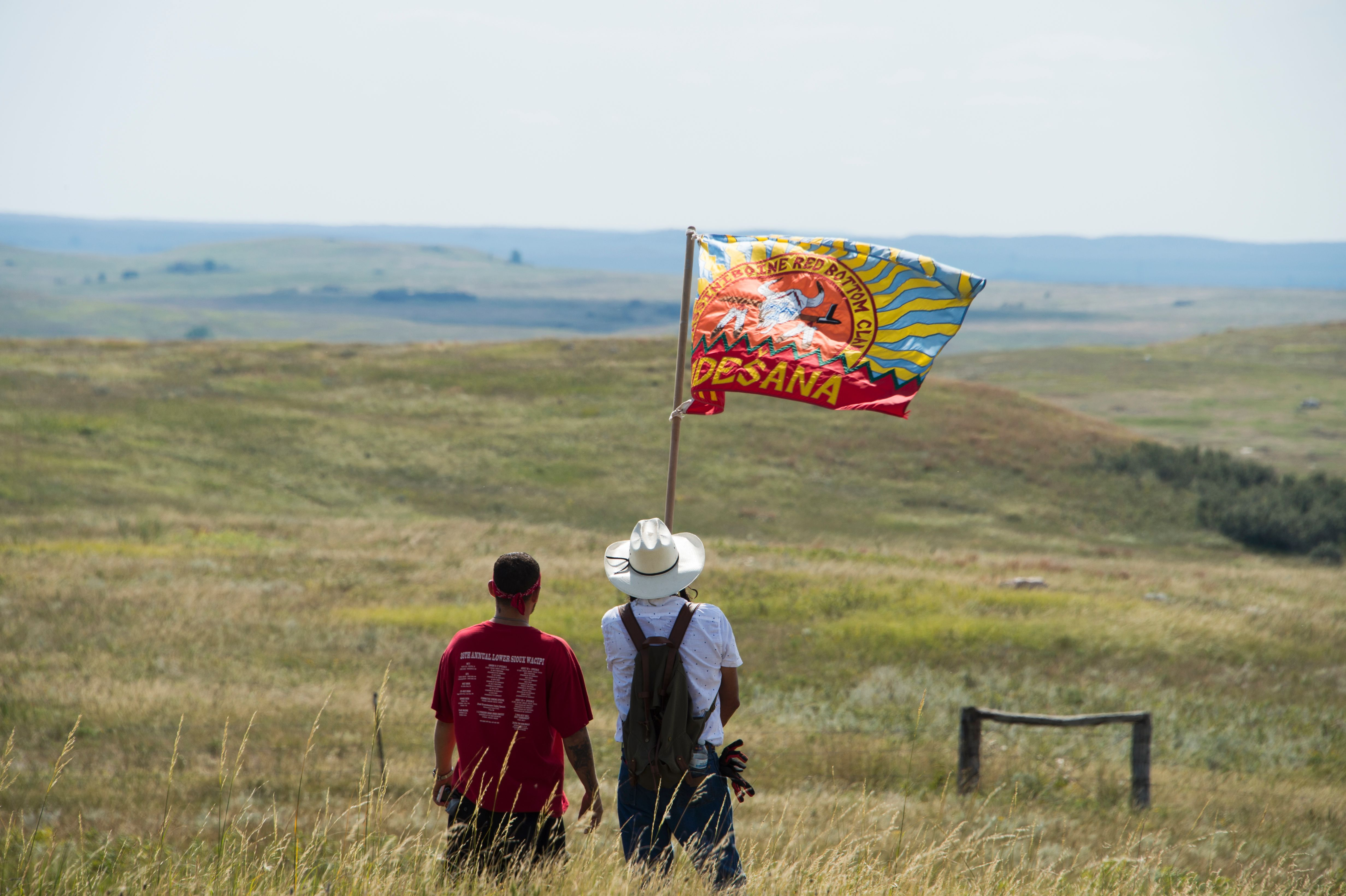 Native American protestors wave a clan flag over land designated for the Dakota Access Pipeline, on  September 3, 2016, near Cannon Ball, North Dakota.
