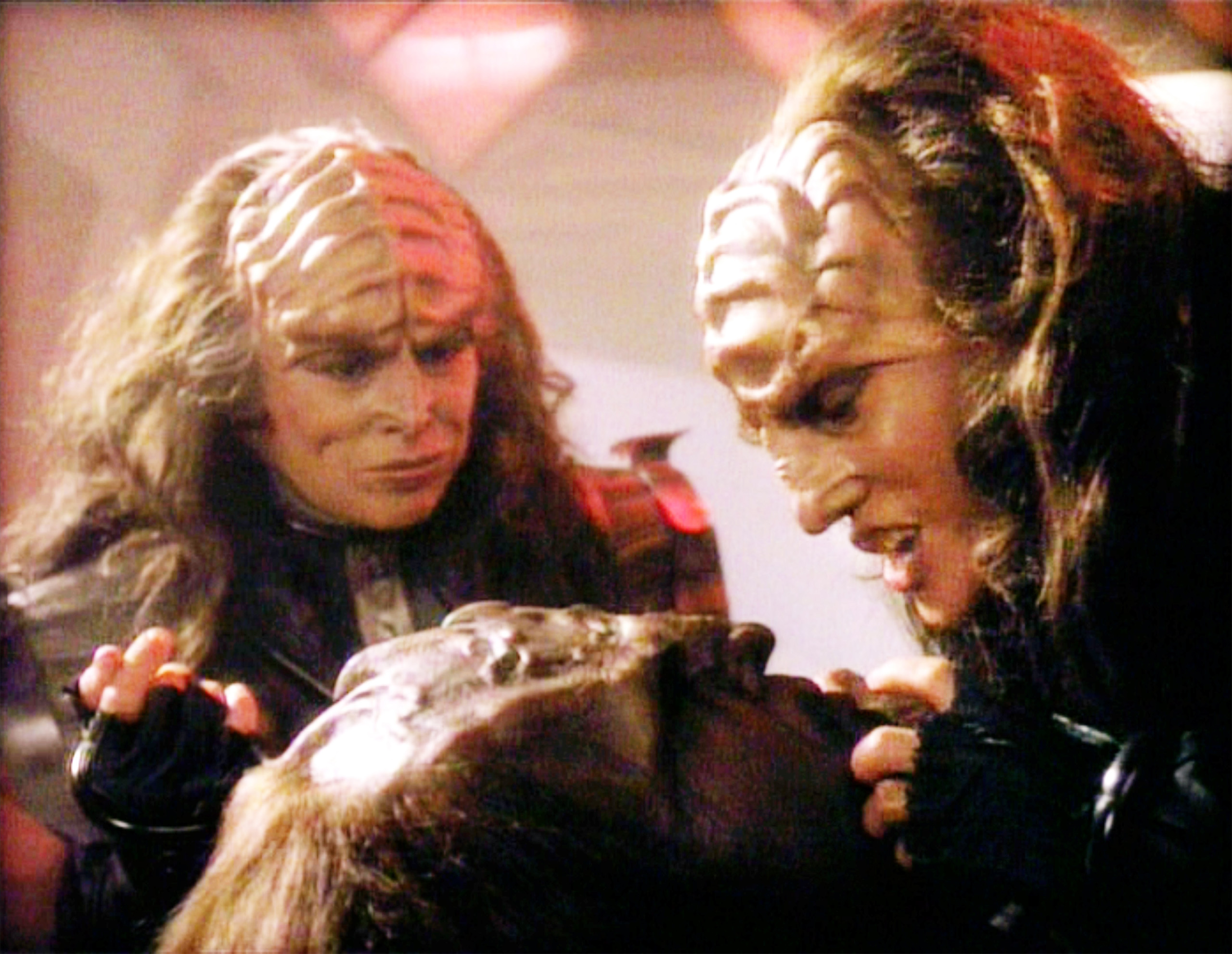 Star Trek: The Next Generation episode, 'Redemption II,' featuring (from left) Barbara March as Lursa and Gwynyth Walsh as B'Etor (the Duras sisters, Klingon). B'Etor faces Worf (played by Michael Dorn). Episode originally broadcast on September 21, 1991.