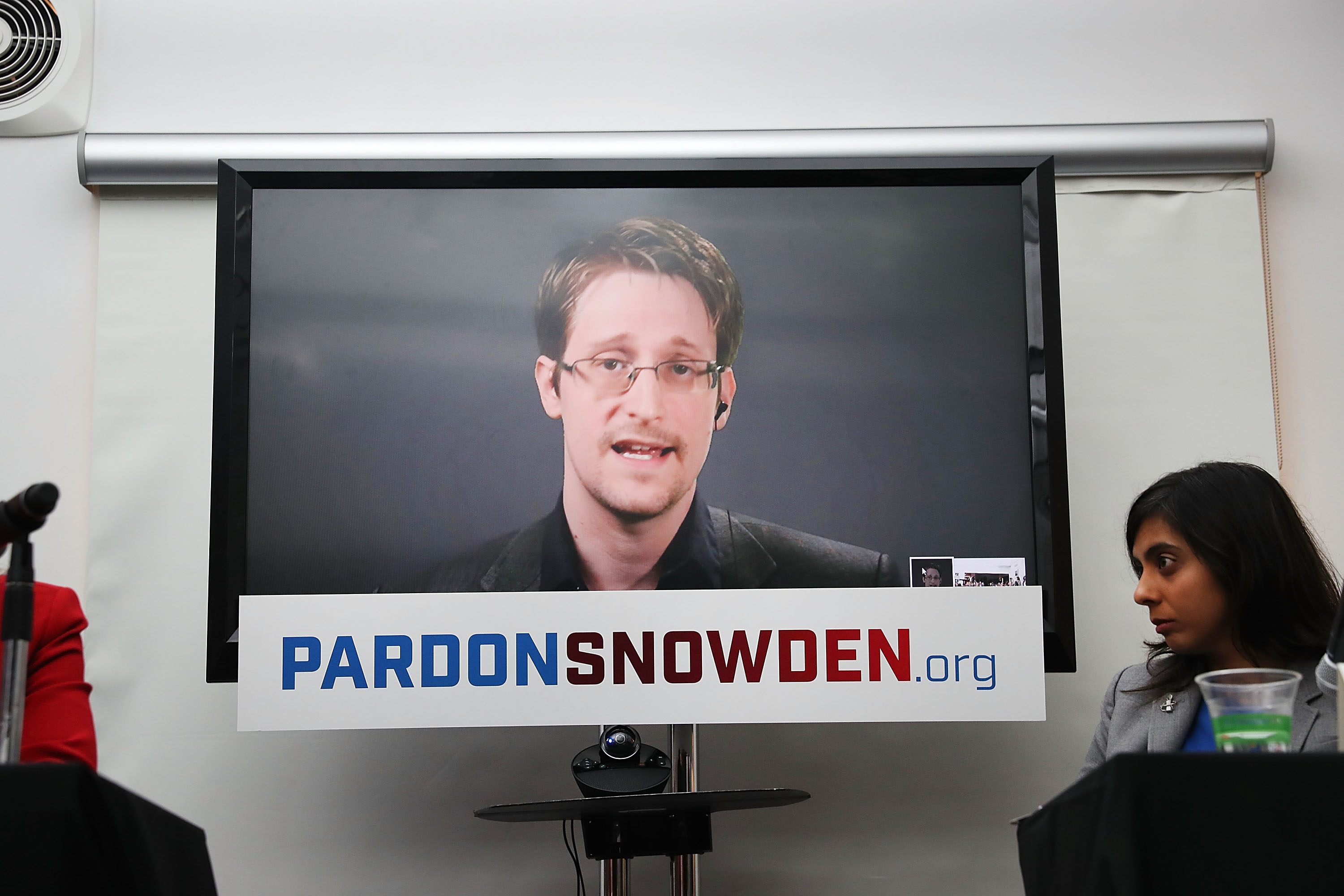 Edward Snowden speaks via video link at a news conference for the launch of a campaign calling for President Obama to pardon him in New York City on Sept. 14, 2016.