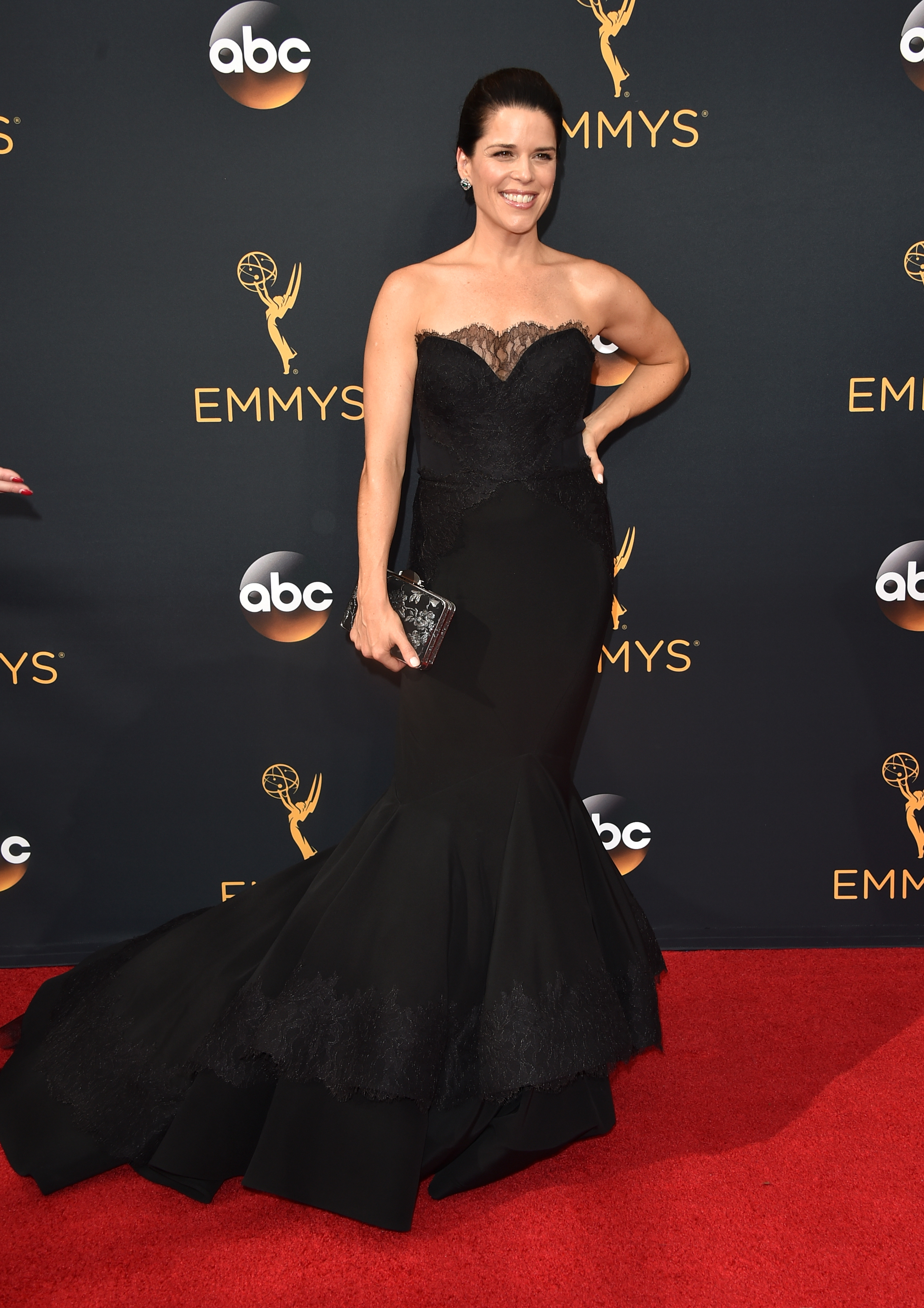 Neve Campbell arrives at the 68th Annual Primetime Emmy Awards at Microsoft Theater on Sept. 18, 2016 in Los Angeles.