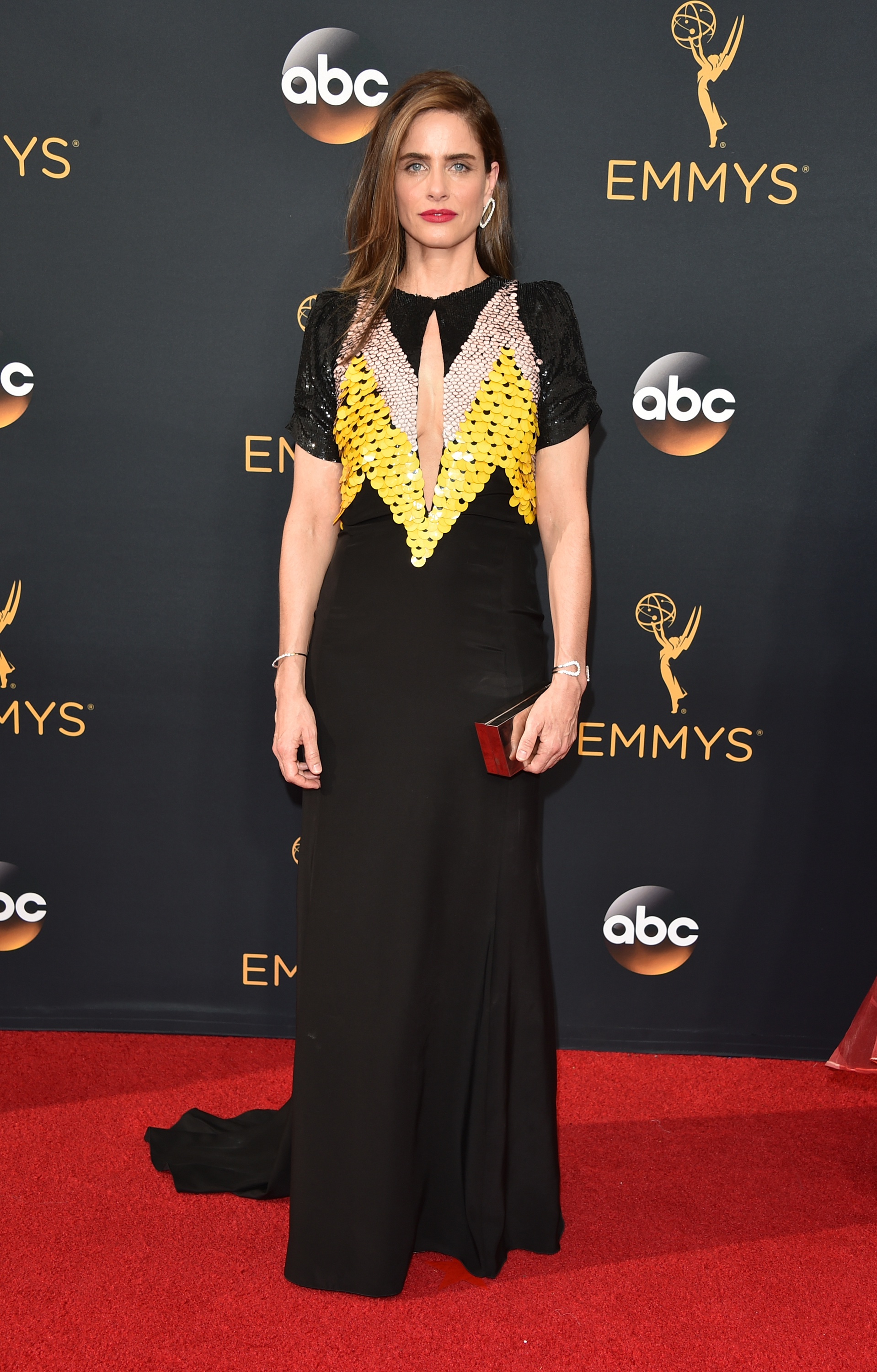 Amanda Peet arrives at the 68th Annual Primetime Emmy Awards at Microsoft Theater on Sept. 18, 2016 in Los Angeles.