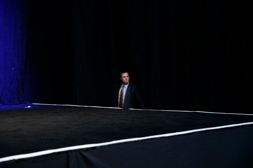 A Secret Service agent waits for the arrival of Republican presidential candidate Donald Trump to a campaign rally, Tuesday, Sept. 13, 2016, in Clive, Iowa.