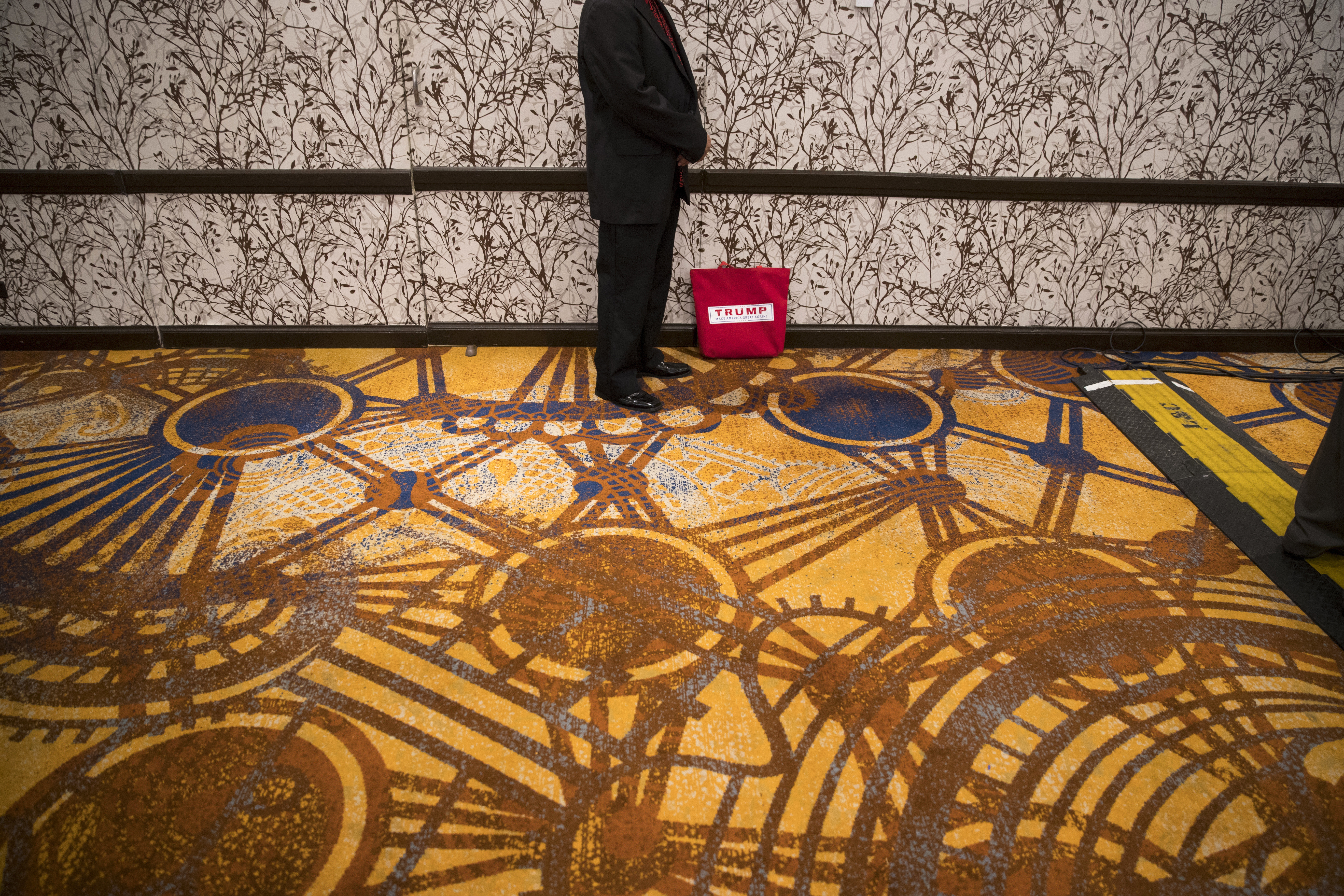 Nathan Paikai, of Honolulu, waits for the arrival of Republican presidential candidate Donald Trump at a reception with friends and family following the Republican National Convention, July 22, 2016, in Cleveland.