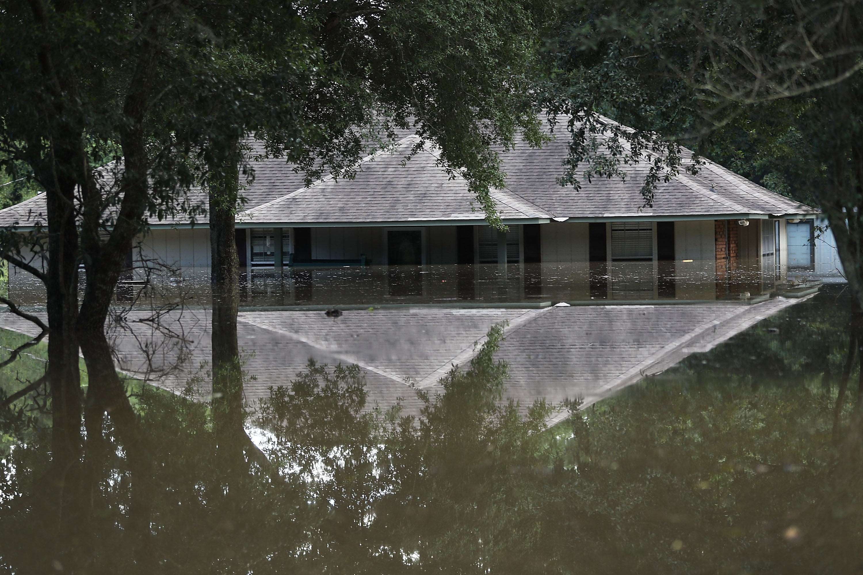 A flooded home is seen on Aug. 15, 2016 in Baton Rouge, Louisiana.