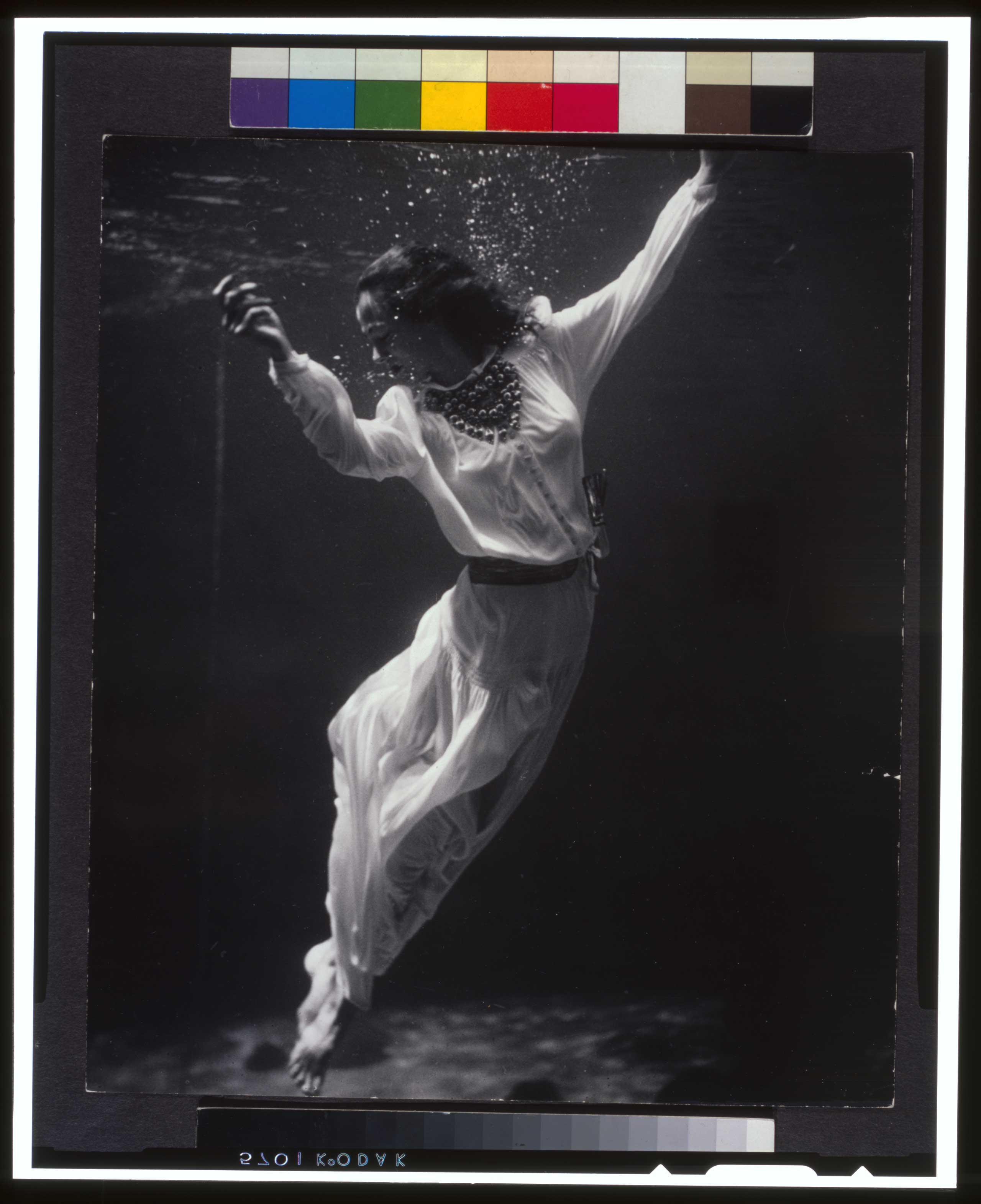 Fashion model underwater in dolphin tank, Marineland, Florida. Published in Vogue, Oct. 1939.