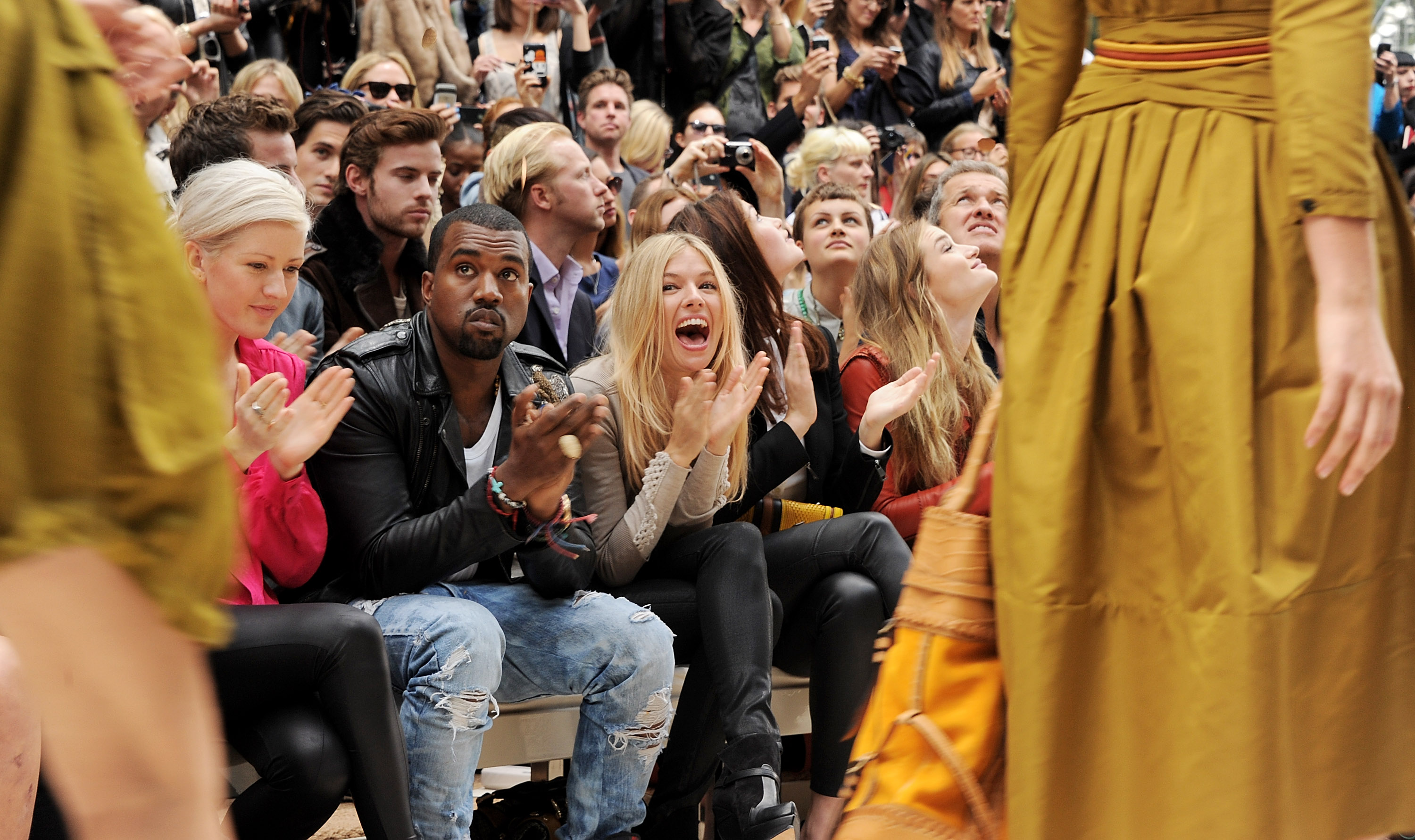 Kanye West and Sienna Miller at the Burberry Spring/Summer 2012 fashion show.