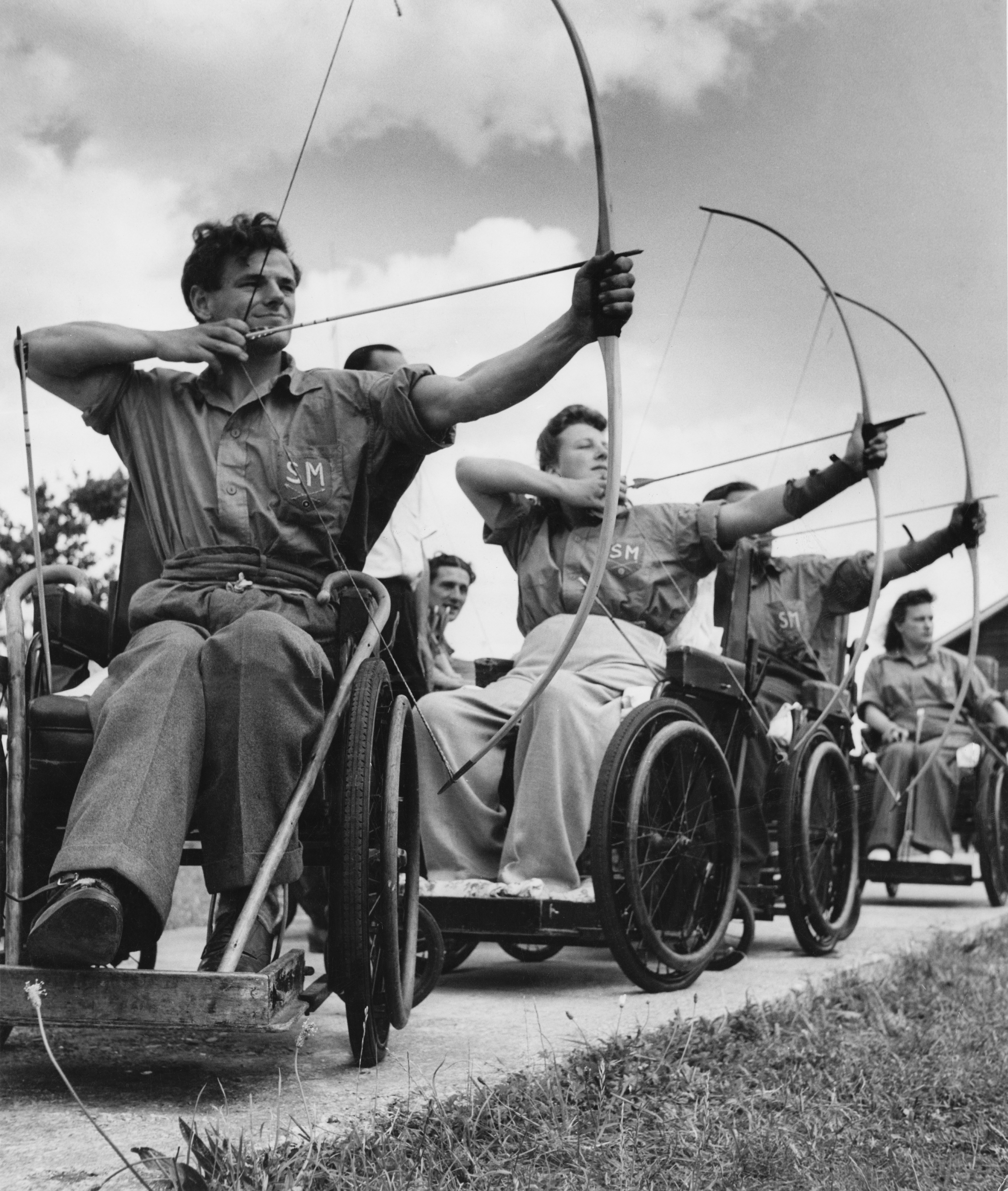 An archery class at the Ministry of Pensions Spinal Centre at Stoke Mandeville Hospital, Buckinghamshire, UK, 1949.
