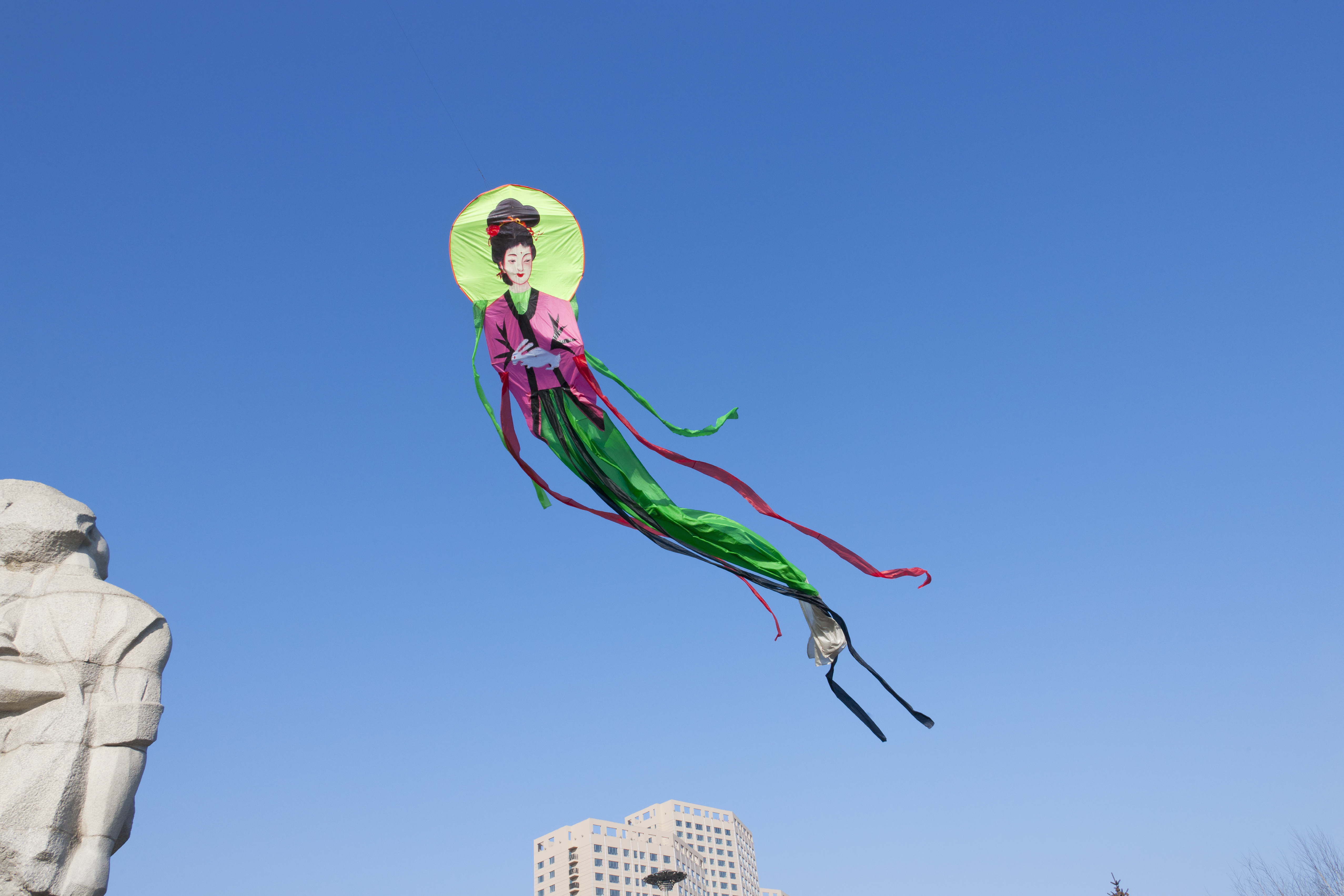 In this undated file photo, a kite of Chang'e, the Chinese moon goddess, flies in Mudanjiang, Heilongjiang province, China