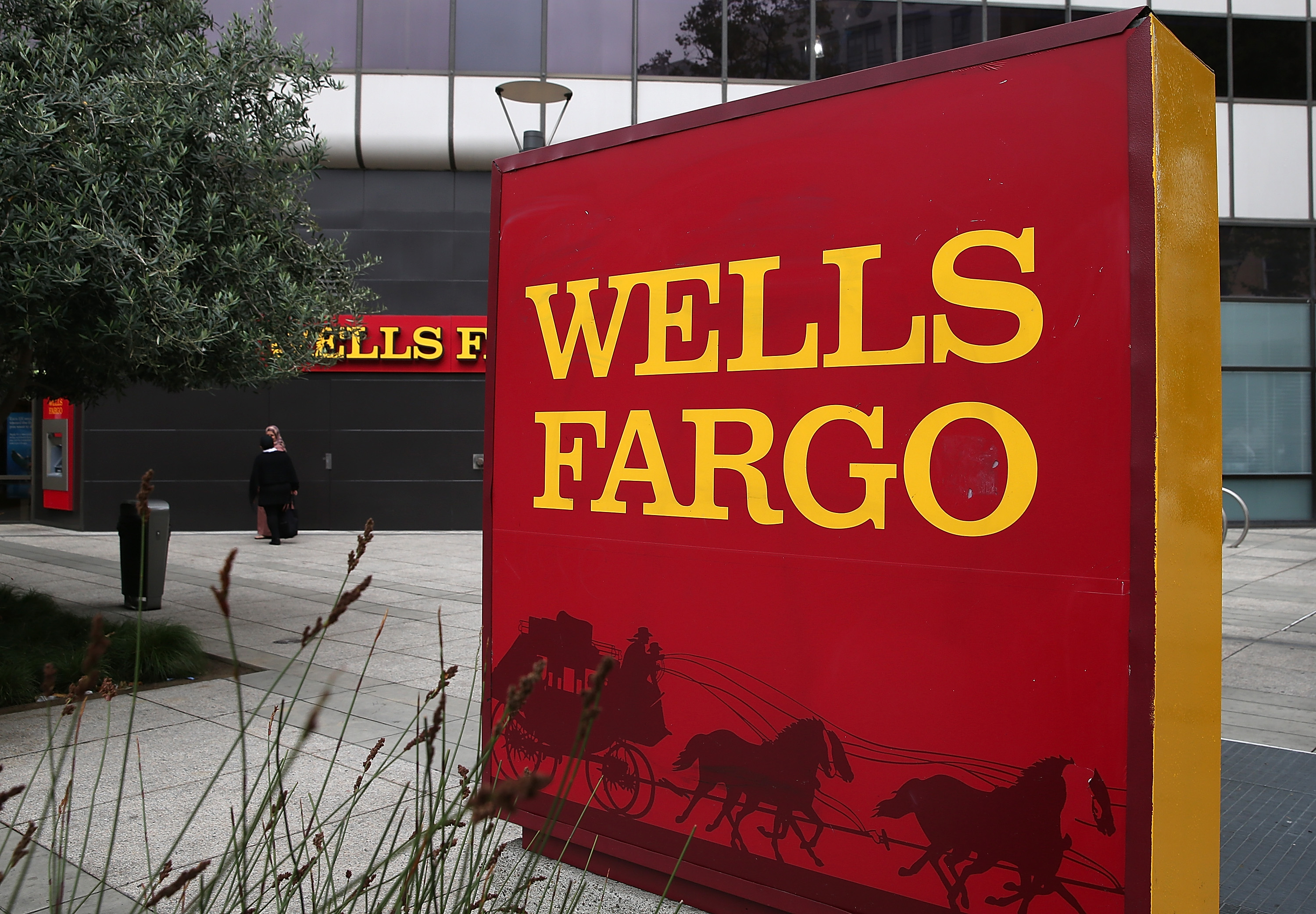 A sign is posted in front of a Wells Fargo bank on October 11, 2013 in Oakland, California.