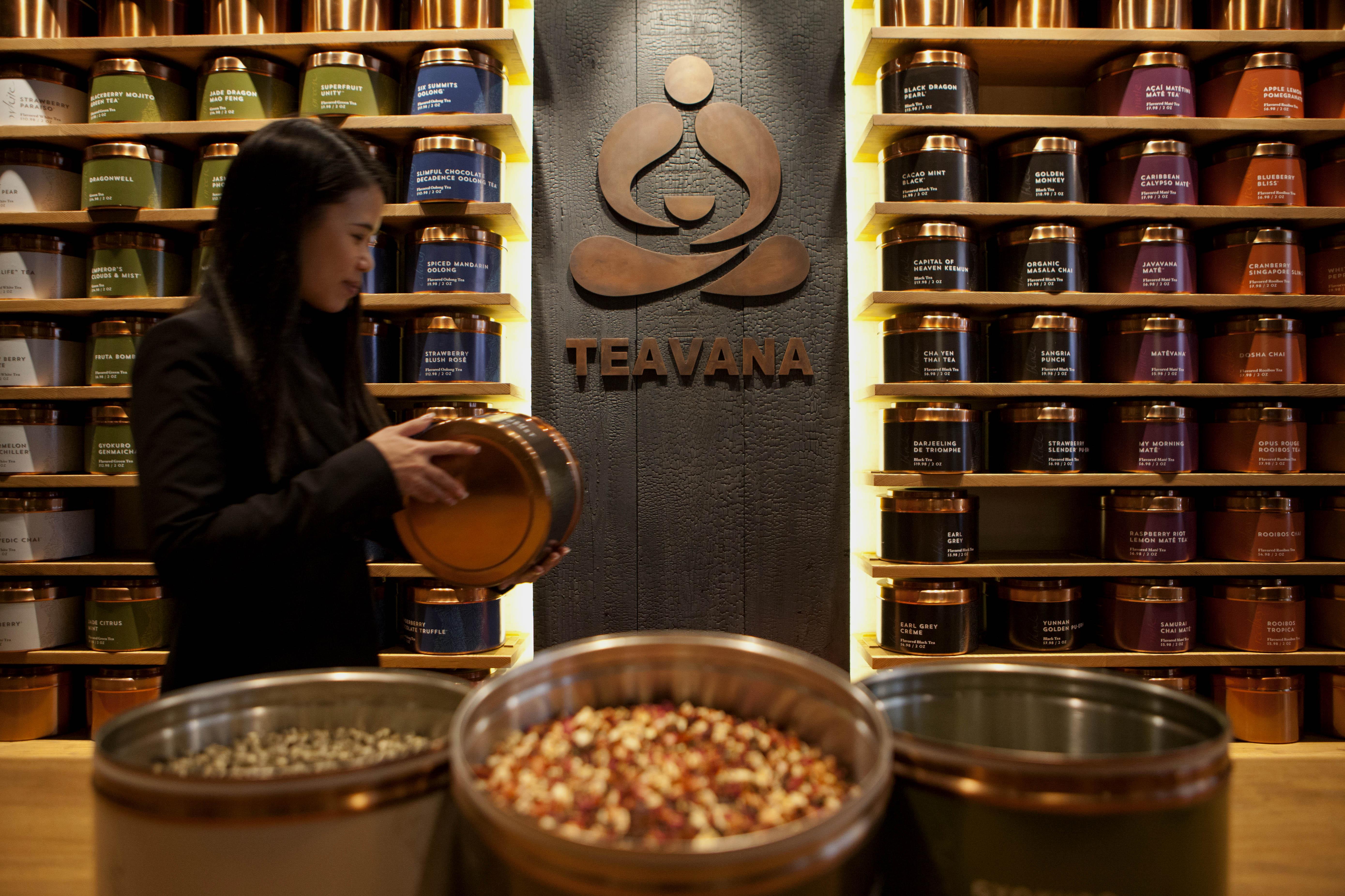 Tins of tea sit stacked at a Teavana tea bar in New York, U.S., on Oct. 24, 2013.