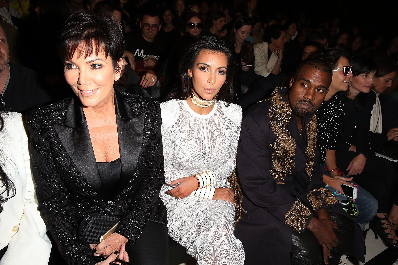 Kris Jenner, Kim Kardashian and Kanye West attend the Spring/Summer 2015 Balmain fashion show.