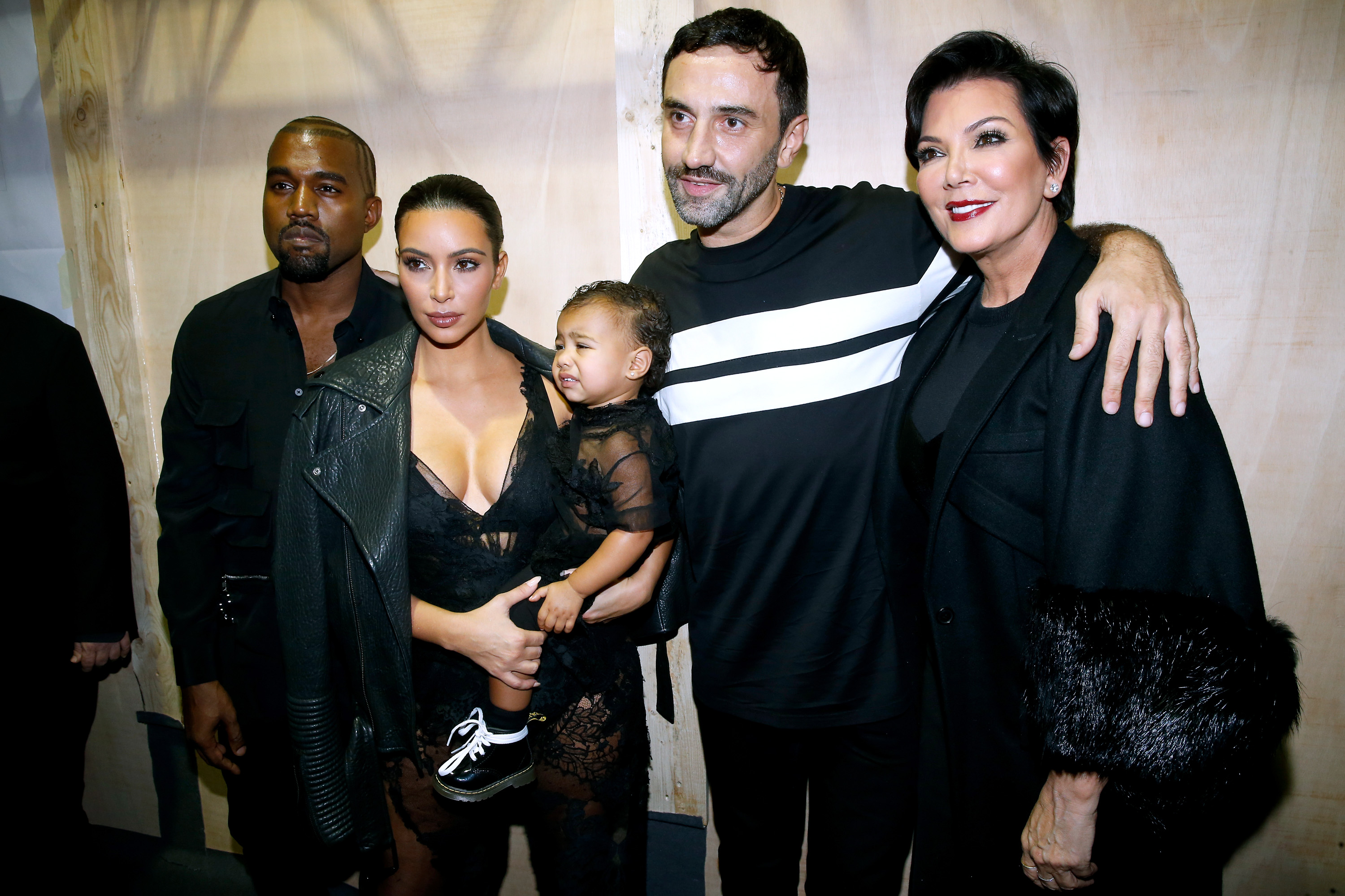 PARIS, FRANCE - SEPTEMBER 28: (L-R) Kim Kardashian, Kanye West, their daughter North West, Mother of Kim Kardashian, Kris Jenner and Fashion designer Riccardo Tisci pose backstage after the Givenchy show as part of the Paris Fashion Week Womenswear Spring/Summer 2015 on September 28, 2014 in Paris, France. (Photo by Bertrand Rindoff Petroff/French Select/Getty Images)