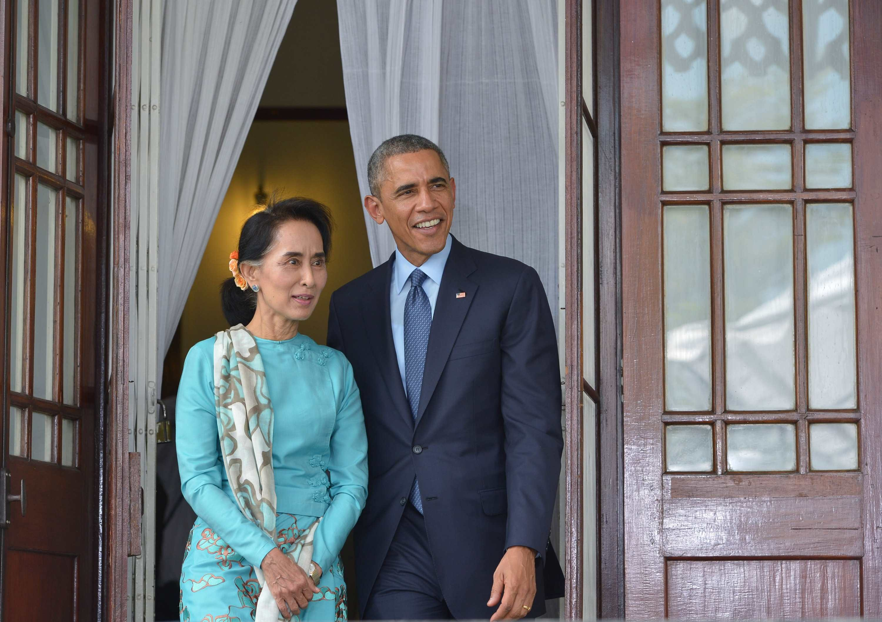 U.S. President Barack Obama and Aung San Suu Kyi arrive for a press conference at her residence in Rangoon on November 14, 2014