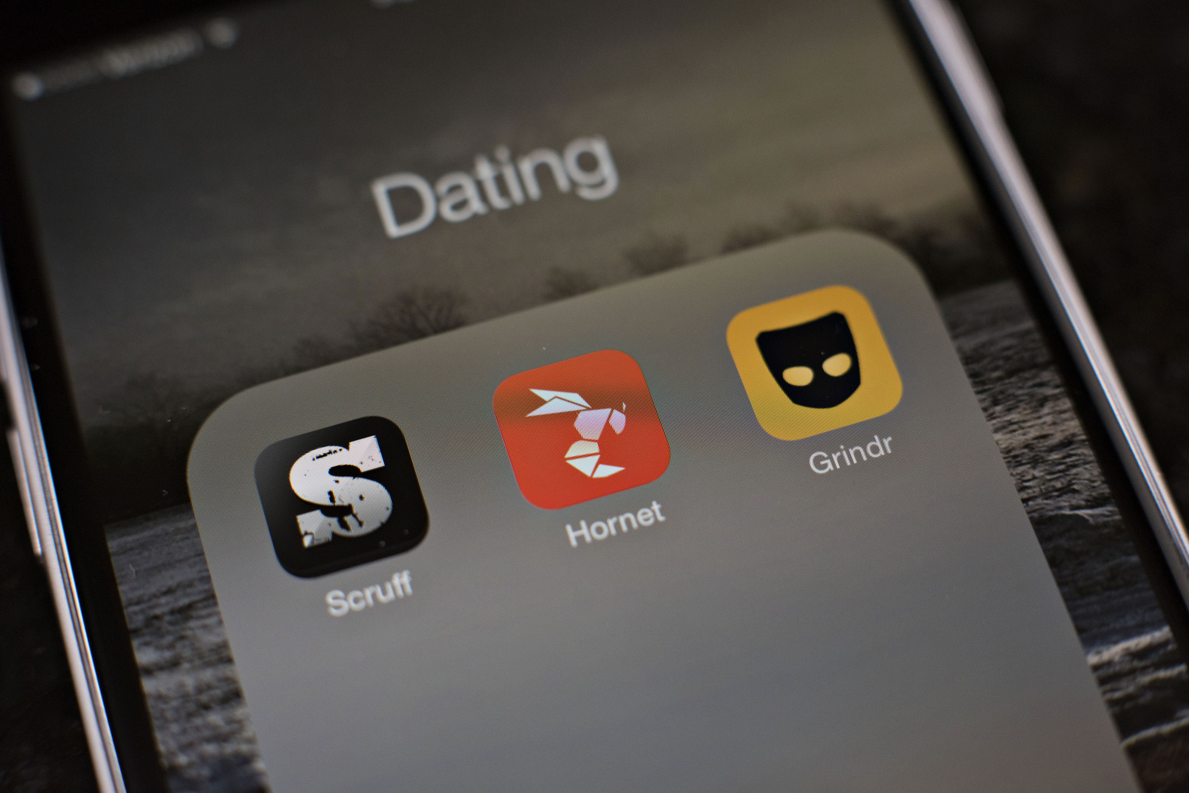 Gay-dating apps Scruff, Hornet and Grindr are displayed on an Apple iPhone