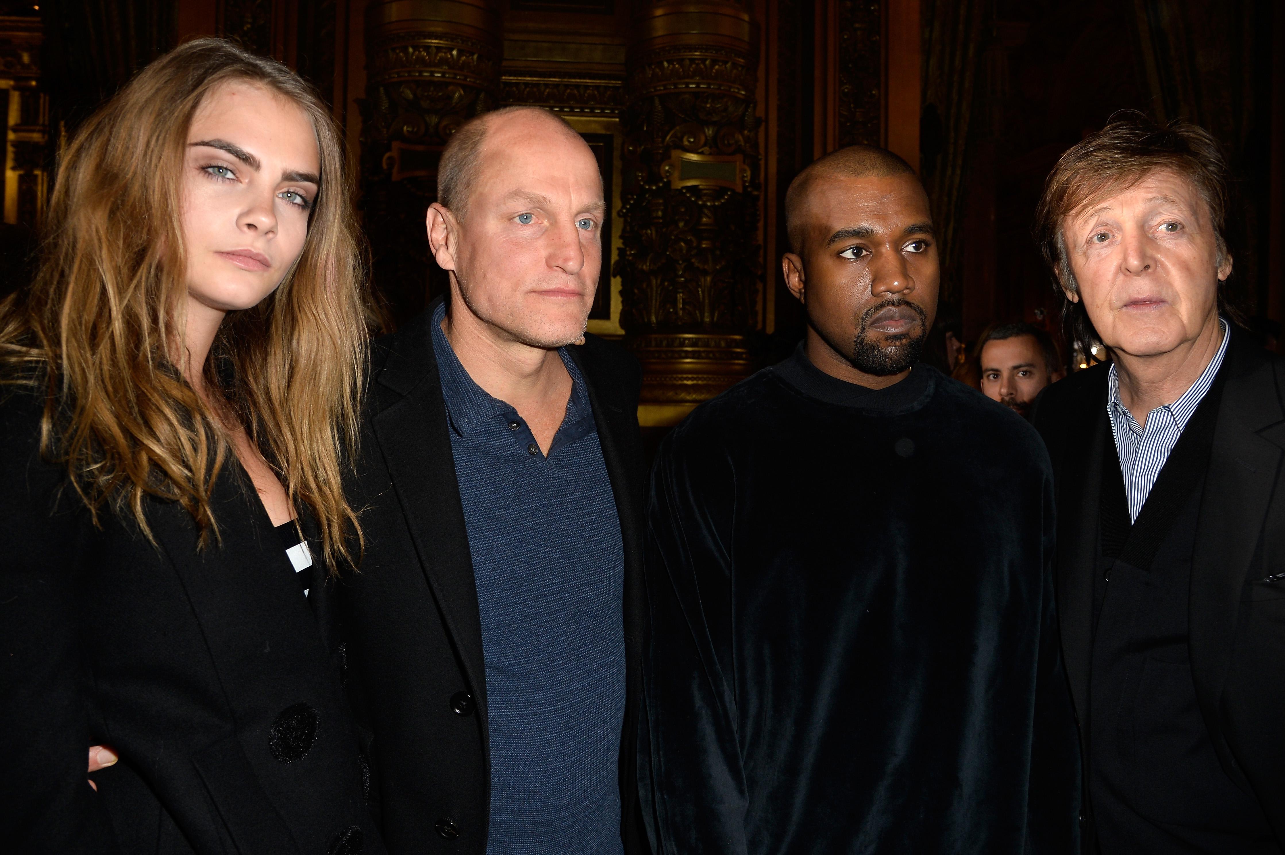 Cara Delevingne, Woody Harrelson, Kanye West and Paul McCartney at the Stella McCartney Fall/Winter 2015 fashion show.