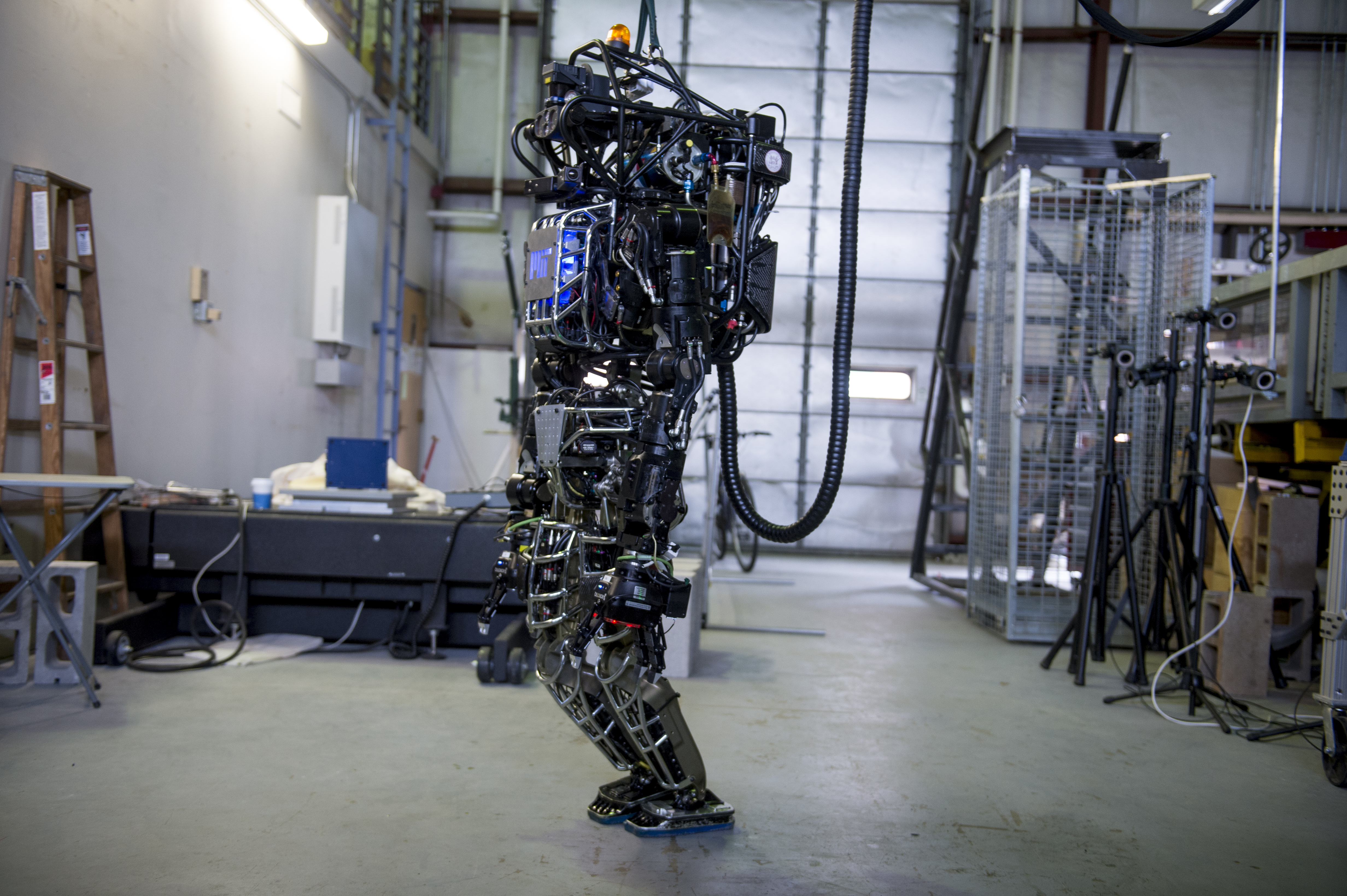 The capabilities of the Atlas robot are demonstrated during the Massachusetts Institute of Technology's Computer Science and Artificial Intelligence Laboratory's Demo Day on April 6, 2013 in Boston, Massachusetts.