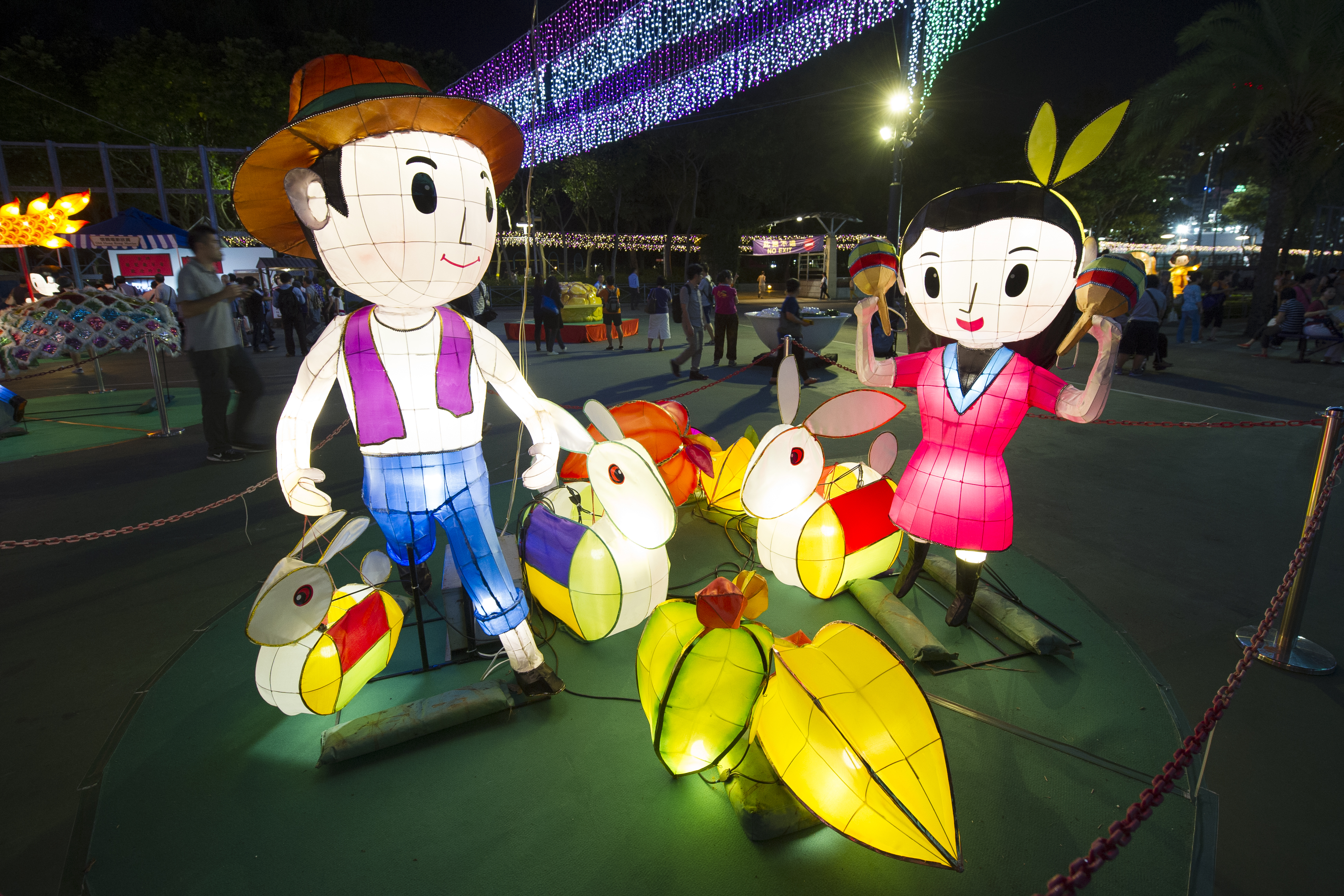 Light decorations are displayed as mid-autumn celebrations take place at dusk on Sept. 24, 2015, in Victoria Park in Hong Kong