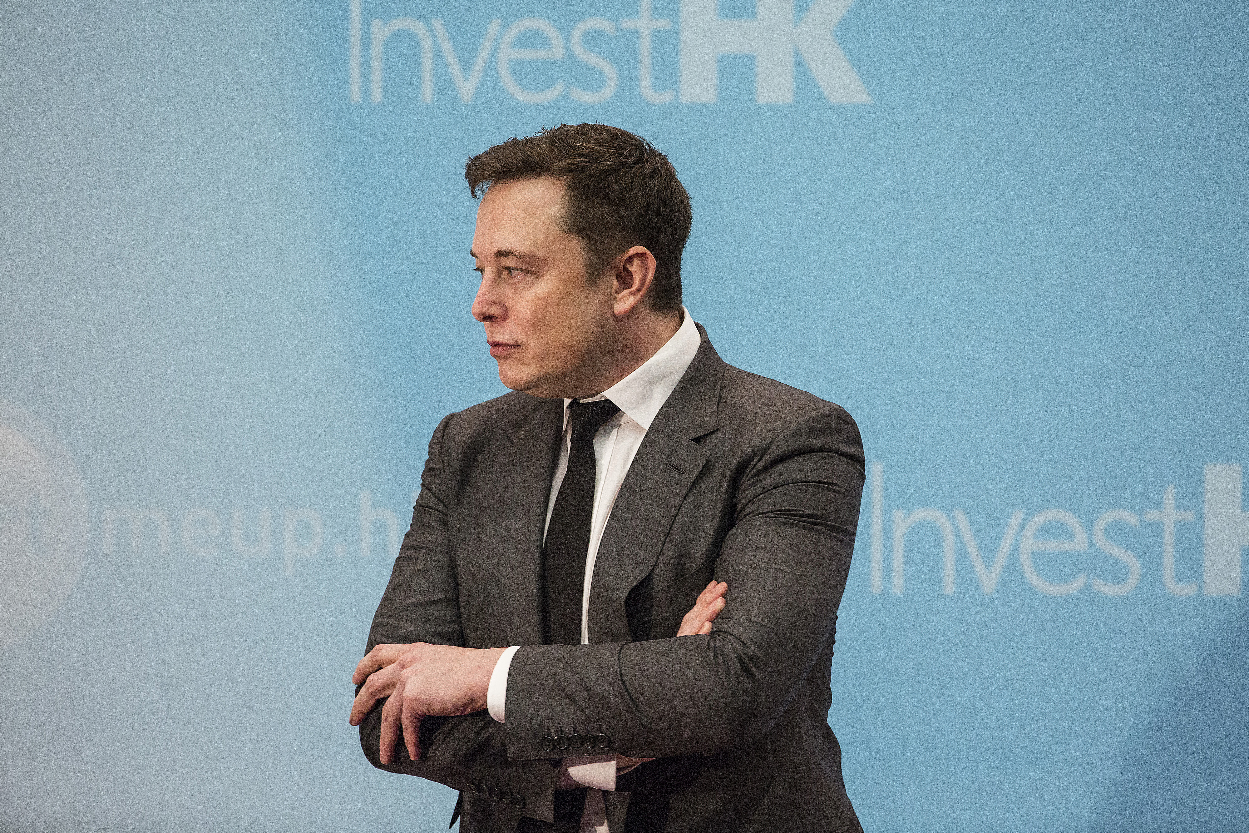 Billionaire Elon Musk, chief executive officer of Tesla Motors Inc., stands on stage during the StartmeupHK Venture Forum in Hong Kong, China, on Tuesday, Jan. 26, 2016.
