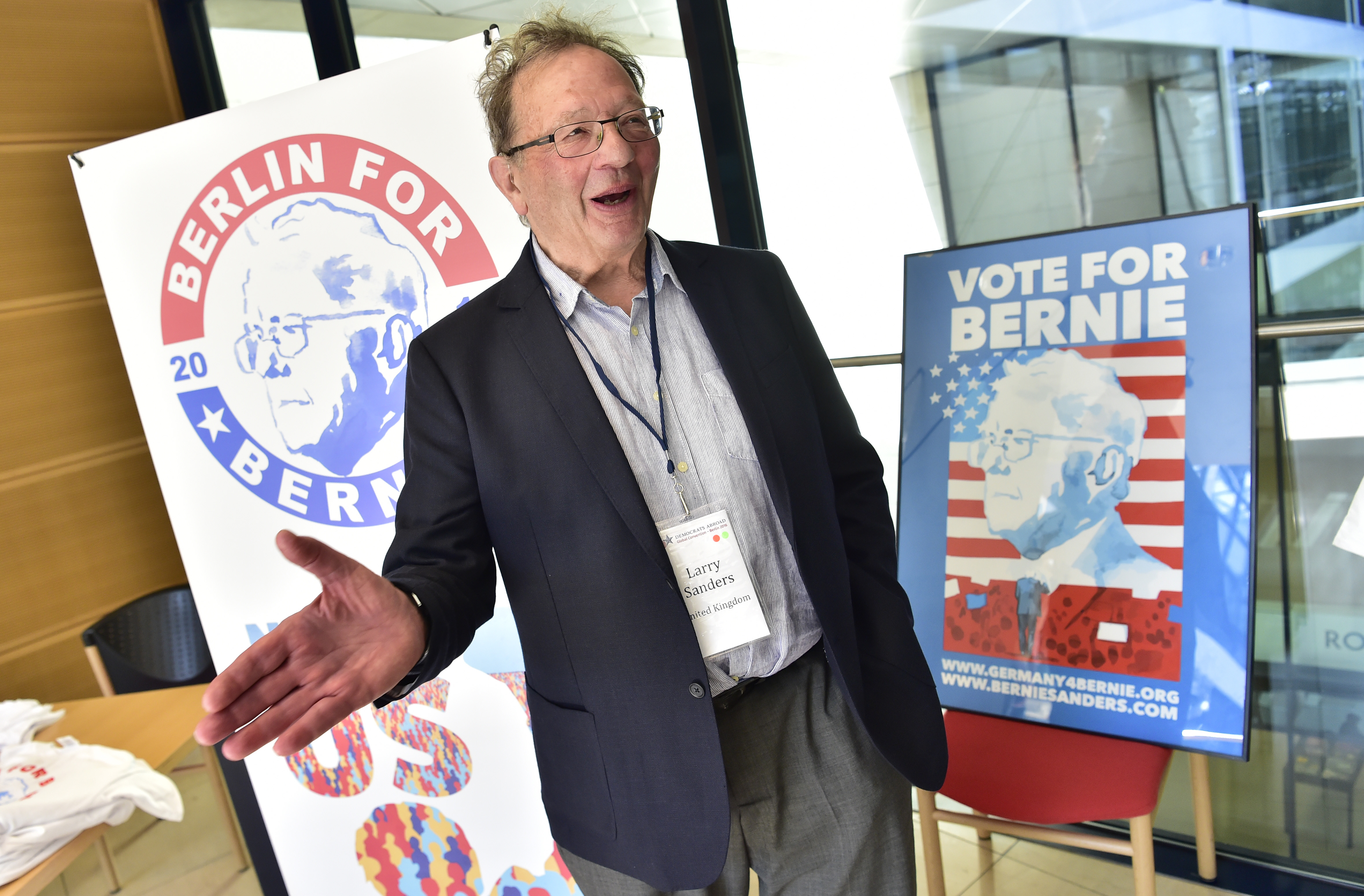 File photo of Larry Sanders, the older brother of Bernie Sanders, speaking to reporters during the Democrats Abroad global convention in Berlin on May 12, 2016